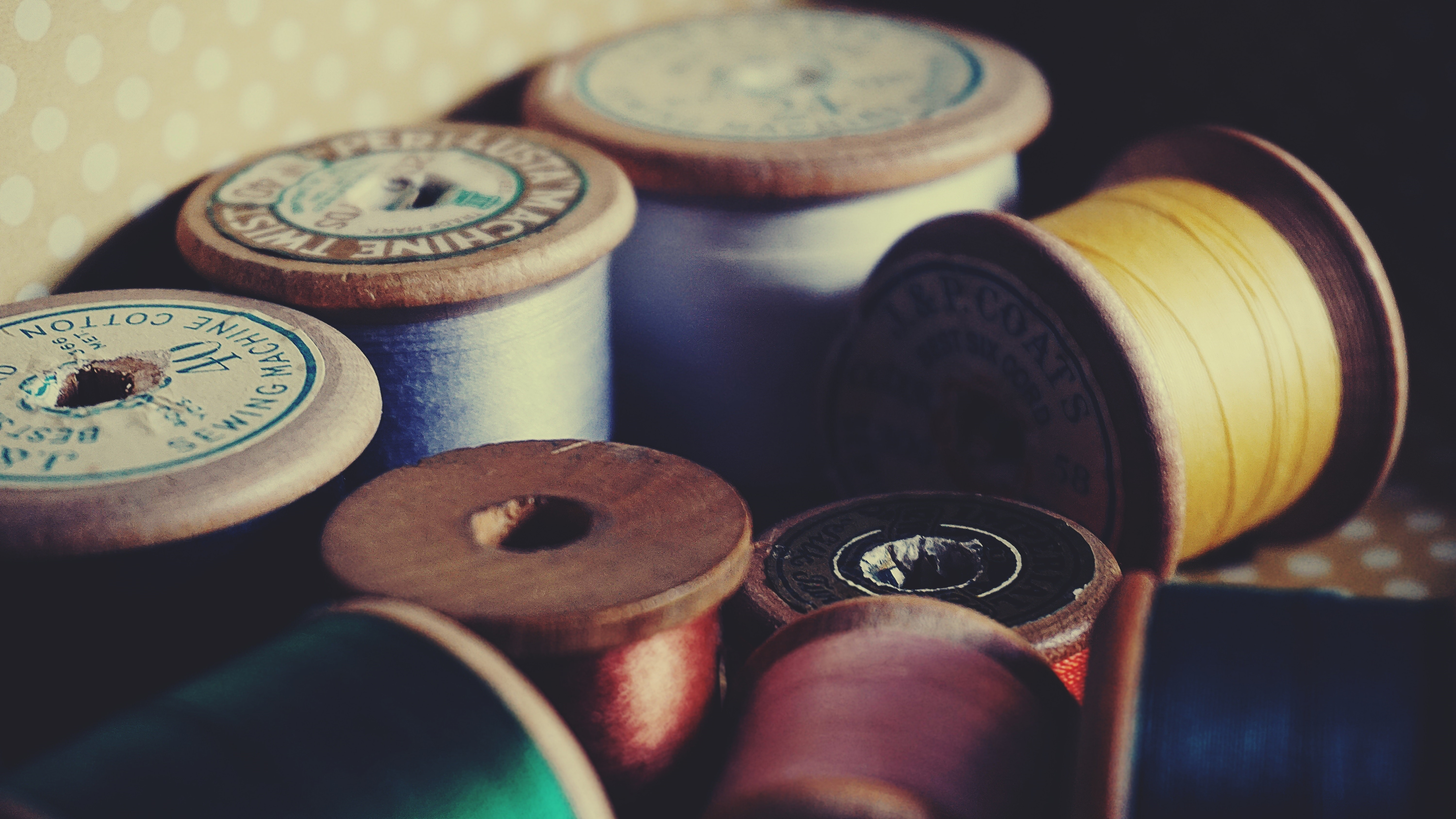 assorted color threads in spools free stock photo