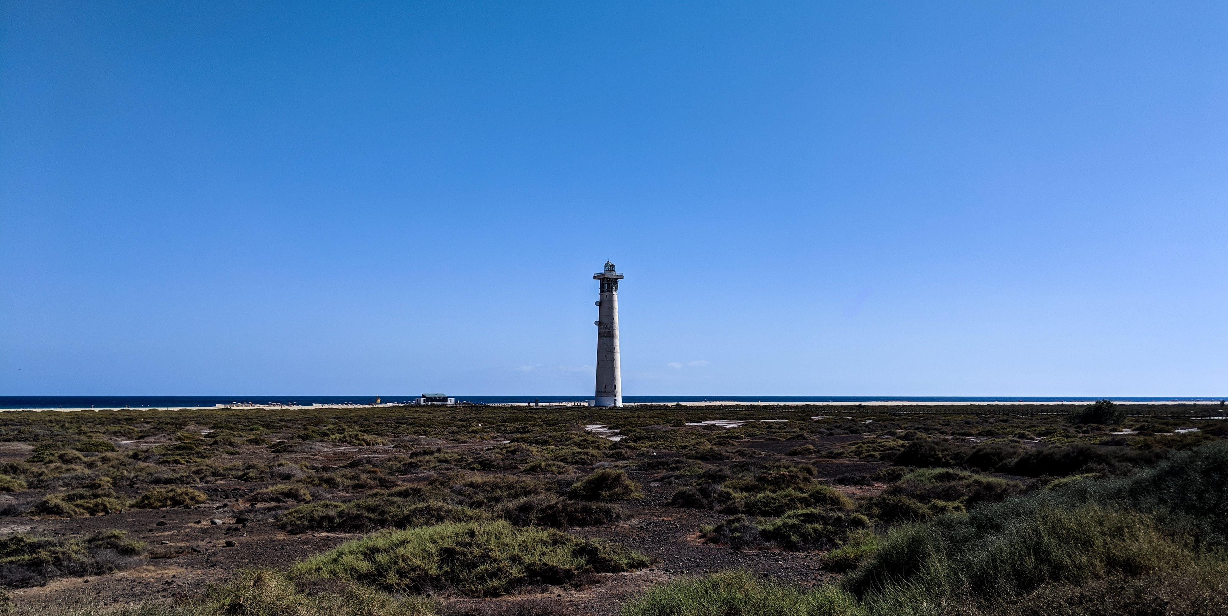 Free stock photo of beach, lighthouse, ocean, sky