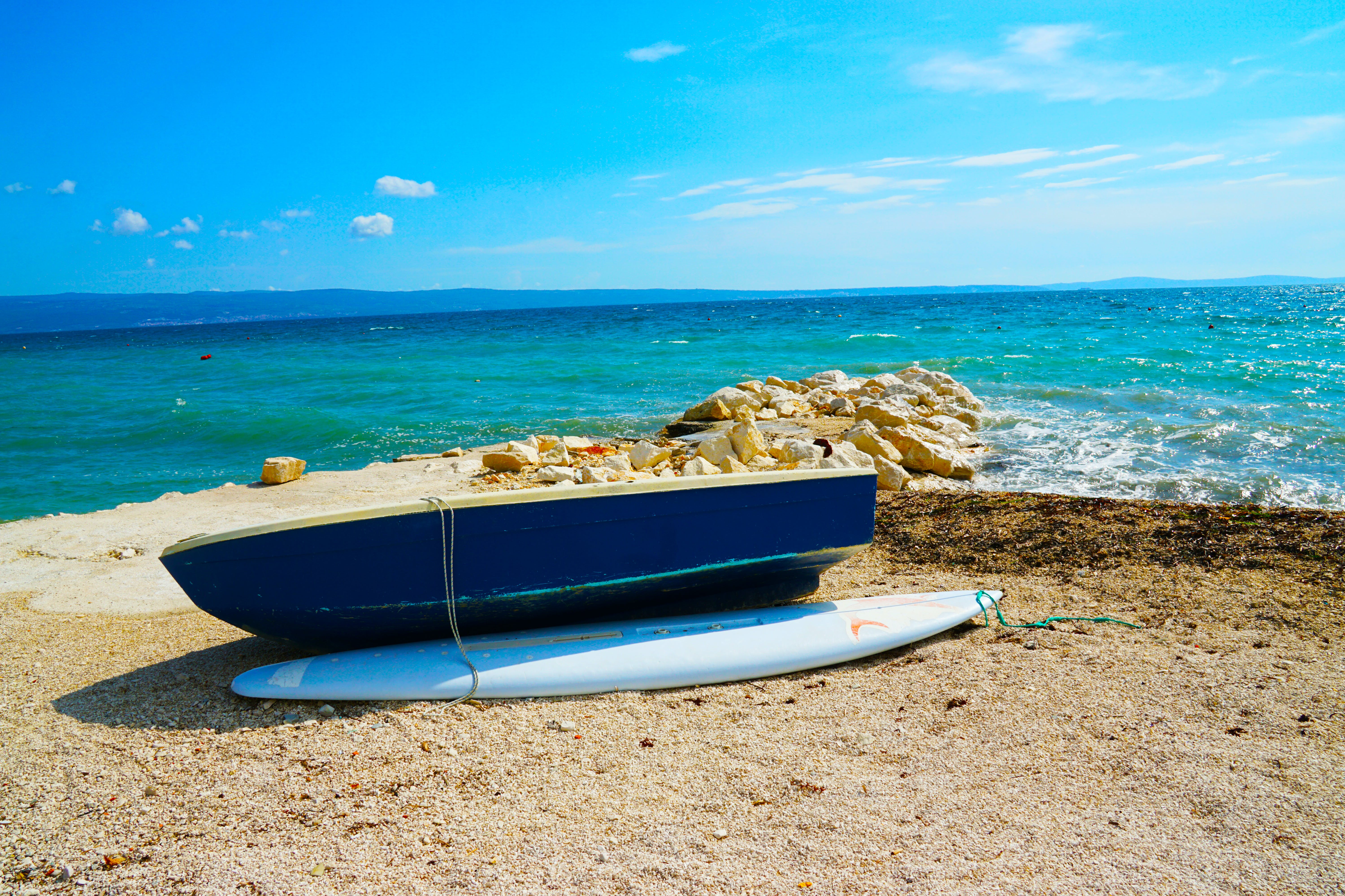 Blue Wooden Dinghy Boat Beside Body of Water