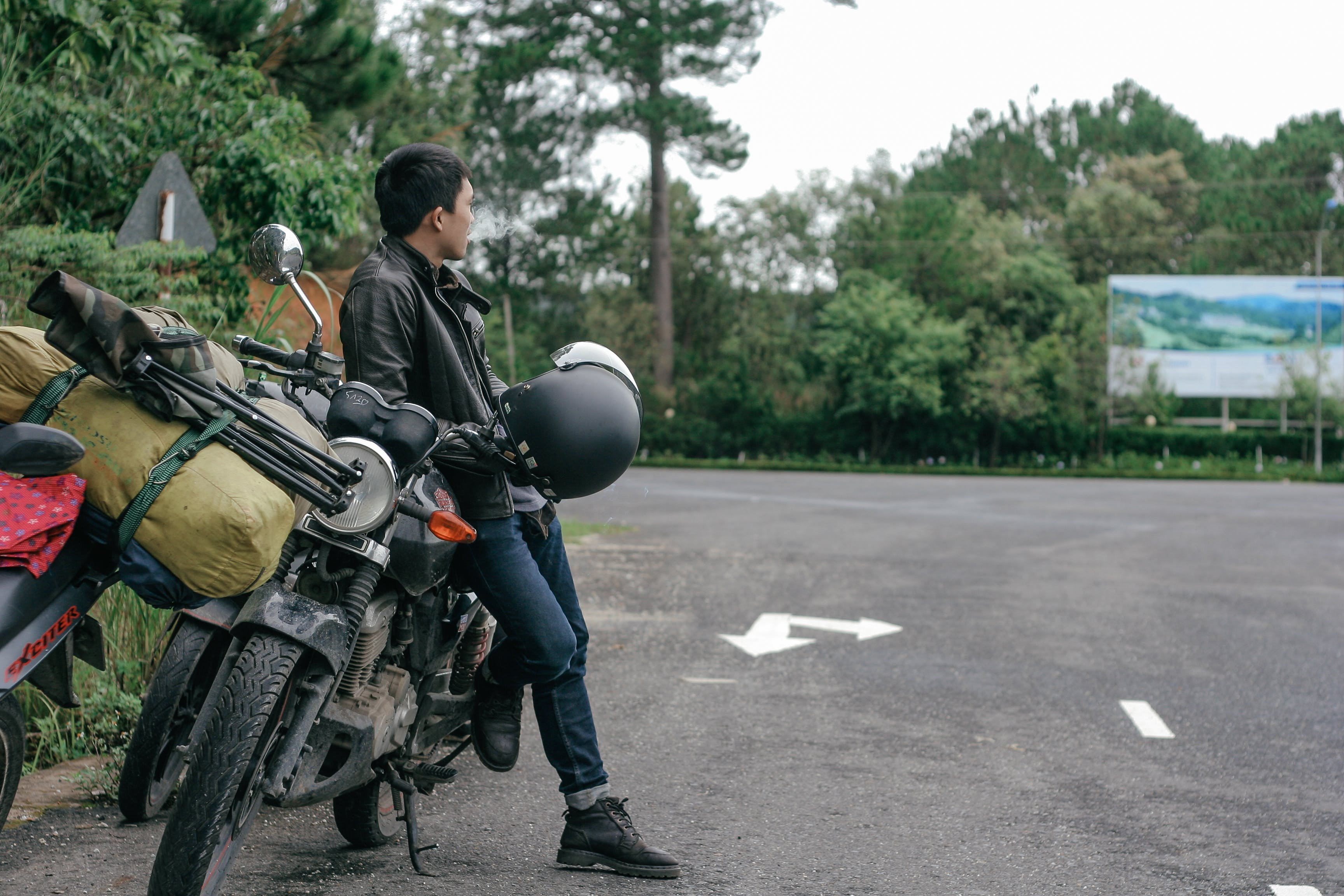 Photo of Man Sitting on Motorcycle
