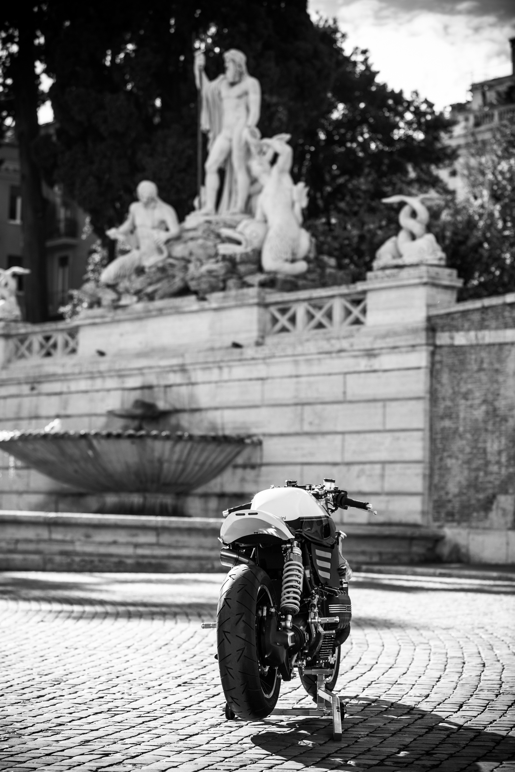 Grayscale Photography of Motorcycle Near Statues