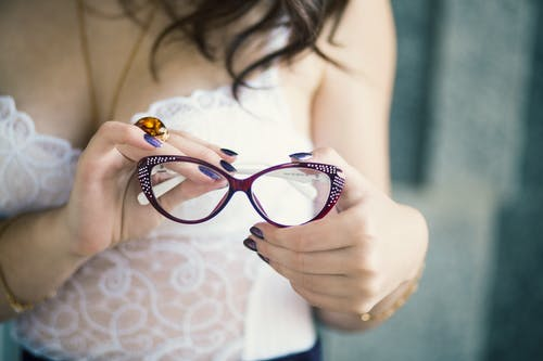 Closeup Photo of Person Holding Eyeglasses