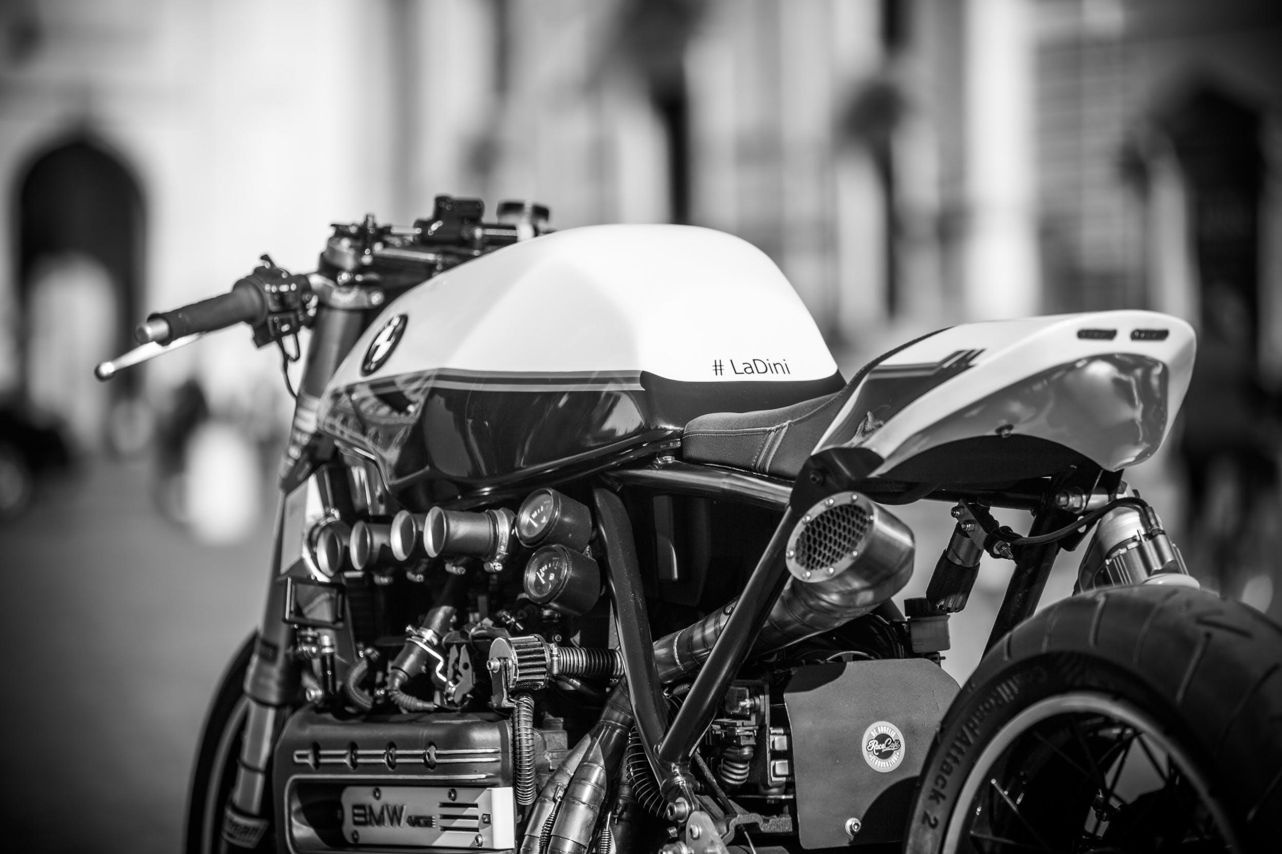 black and white, blurred background, BMW