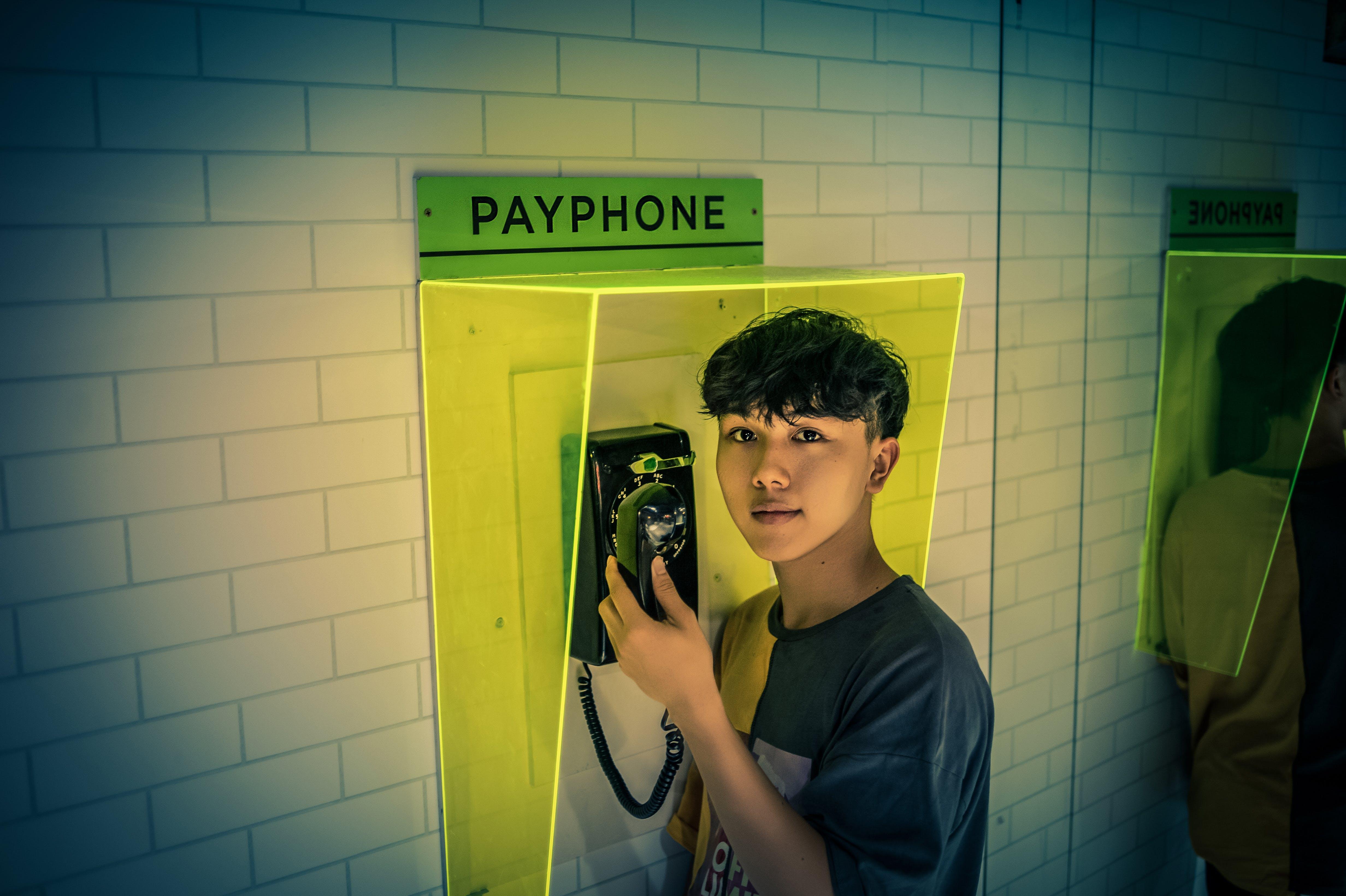 Man Holding Telephone