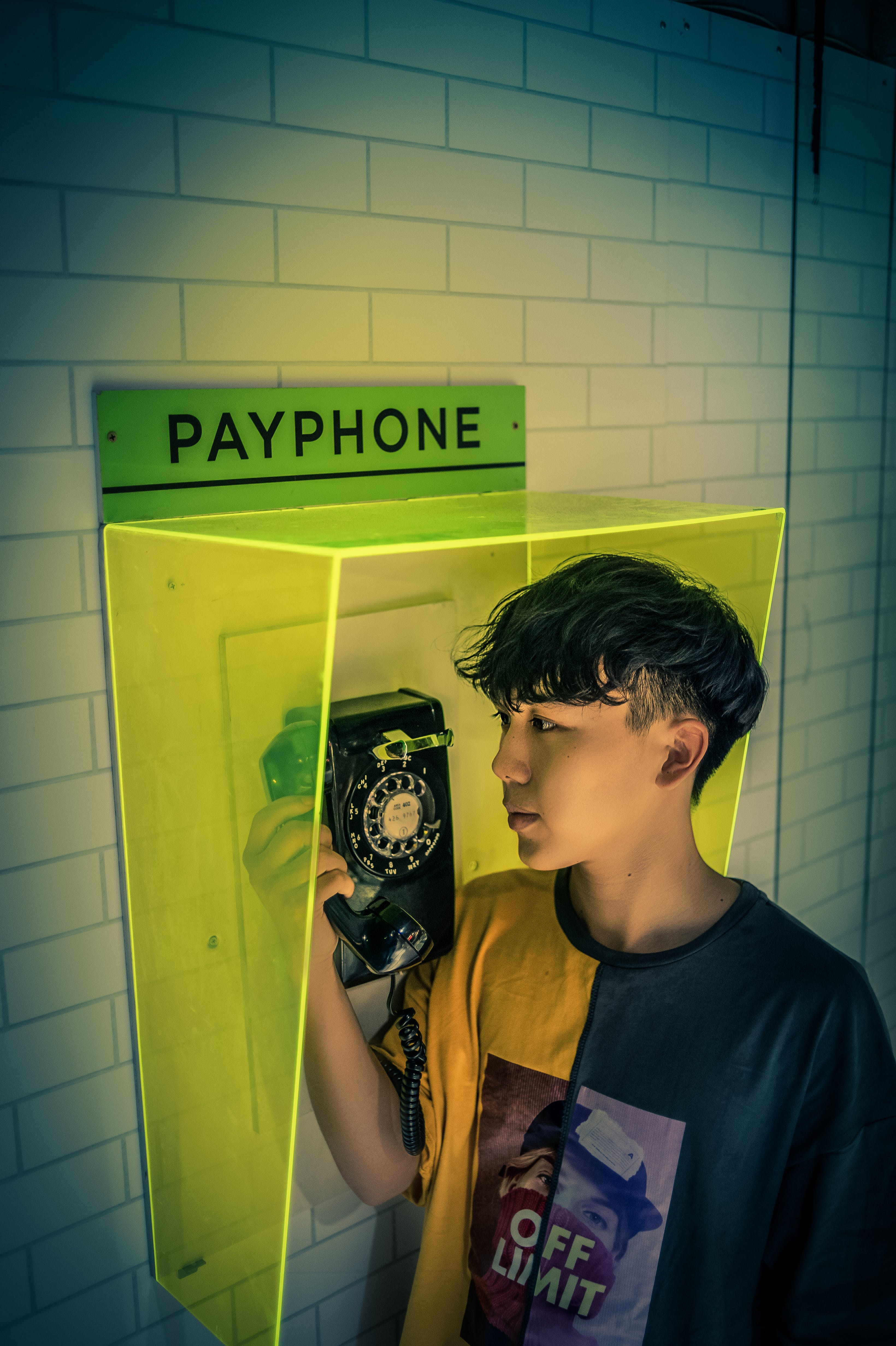 Boy holding Payphone receiver