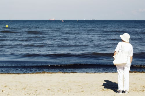 Photo of Woman Standing on Seashore