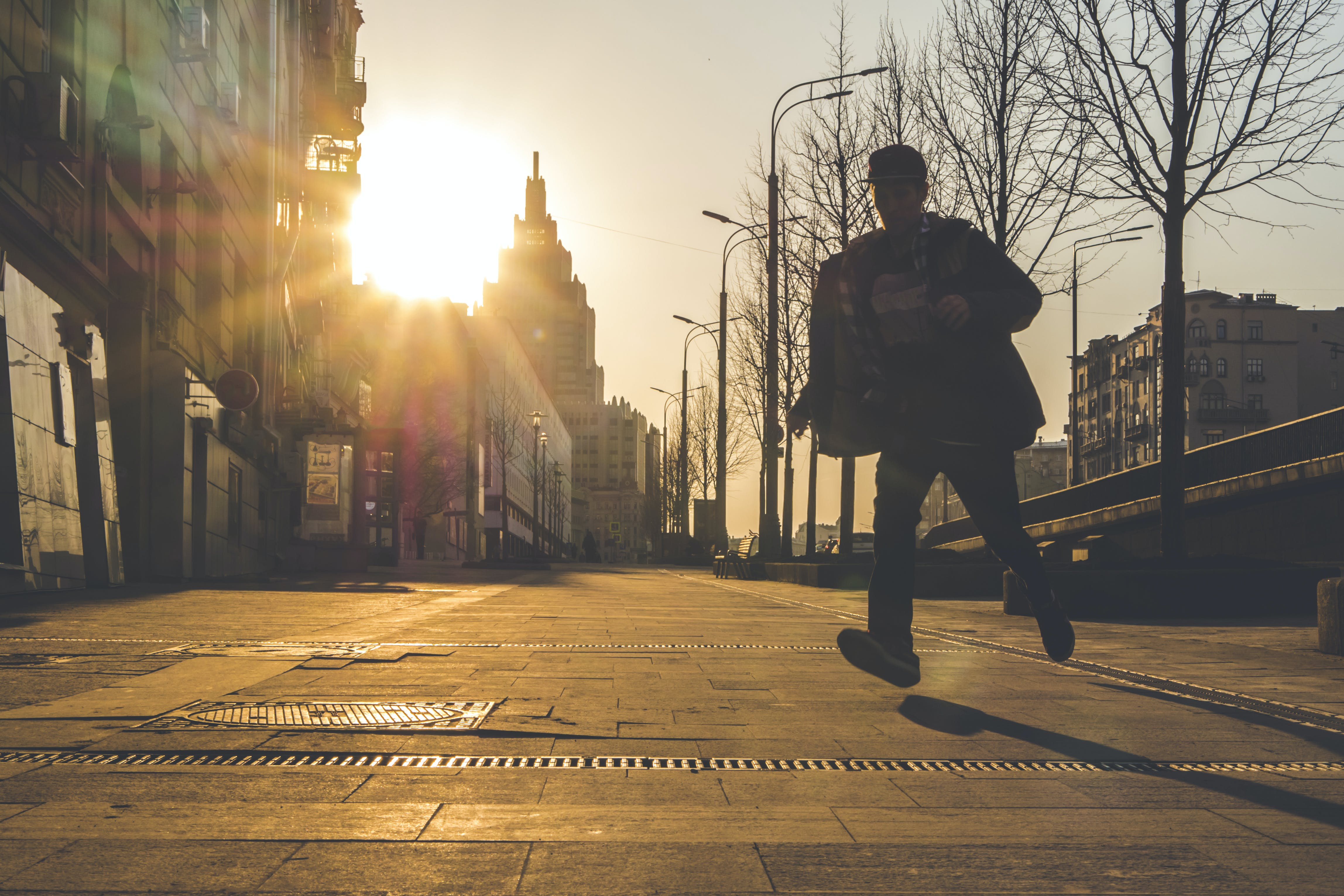 Man Running on Street during Sunset