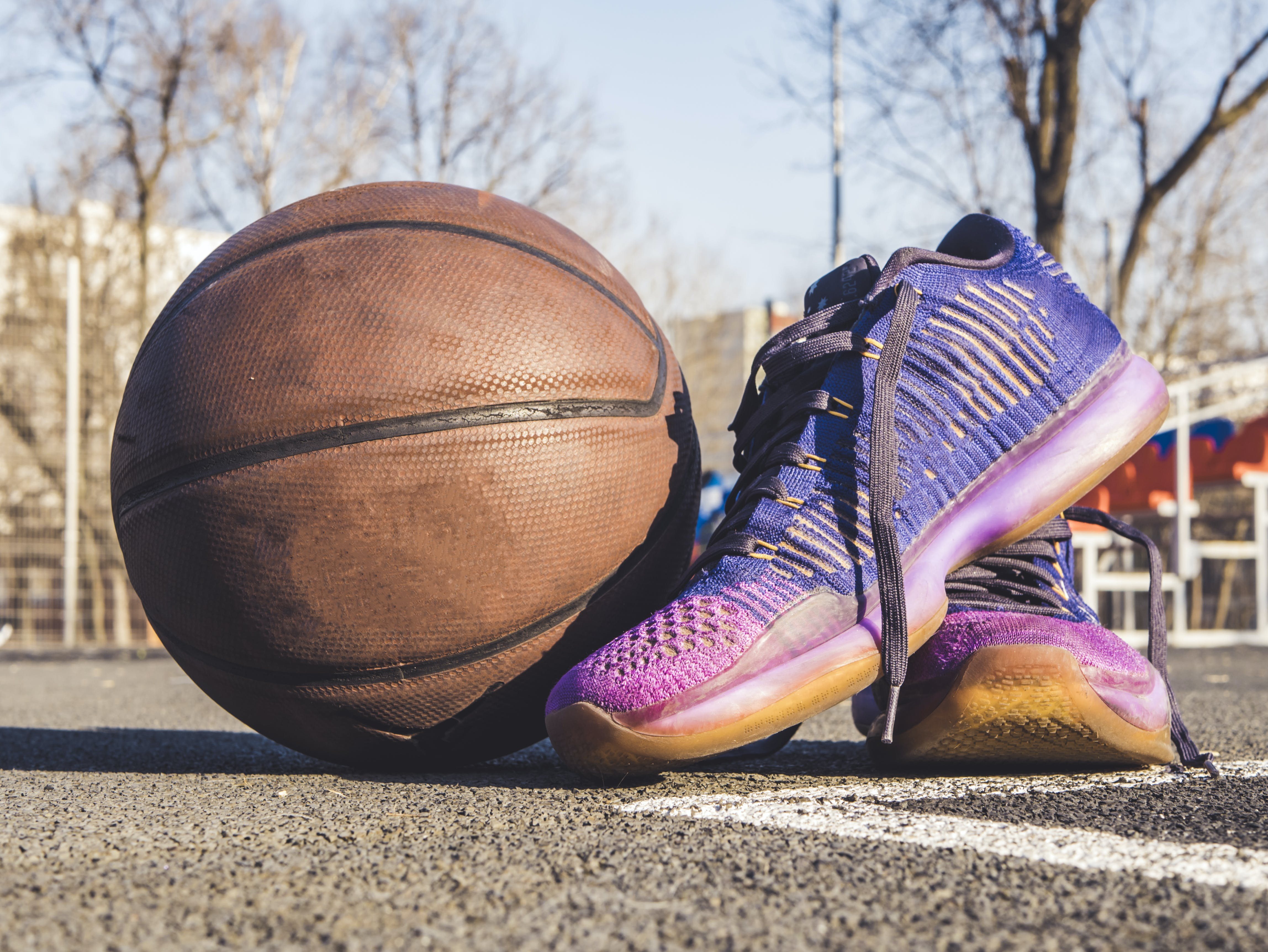 Close-Up Photography of Shoes Near Ball