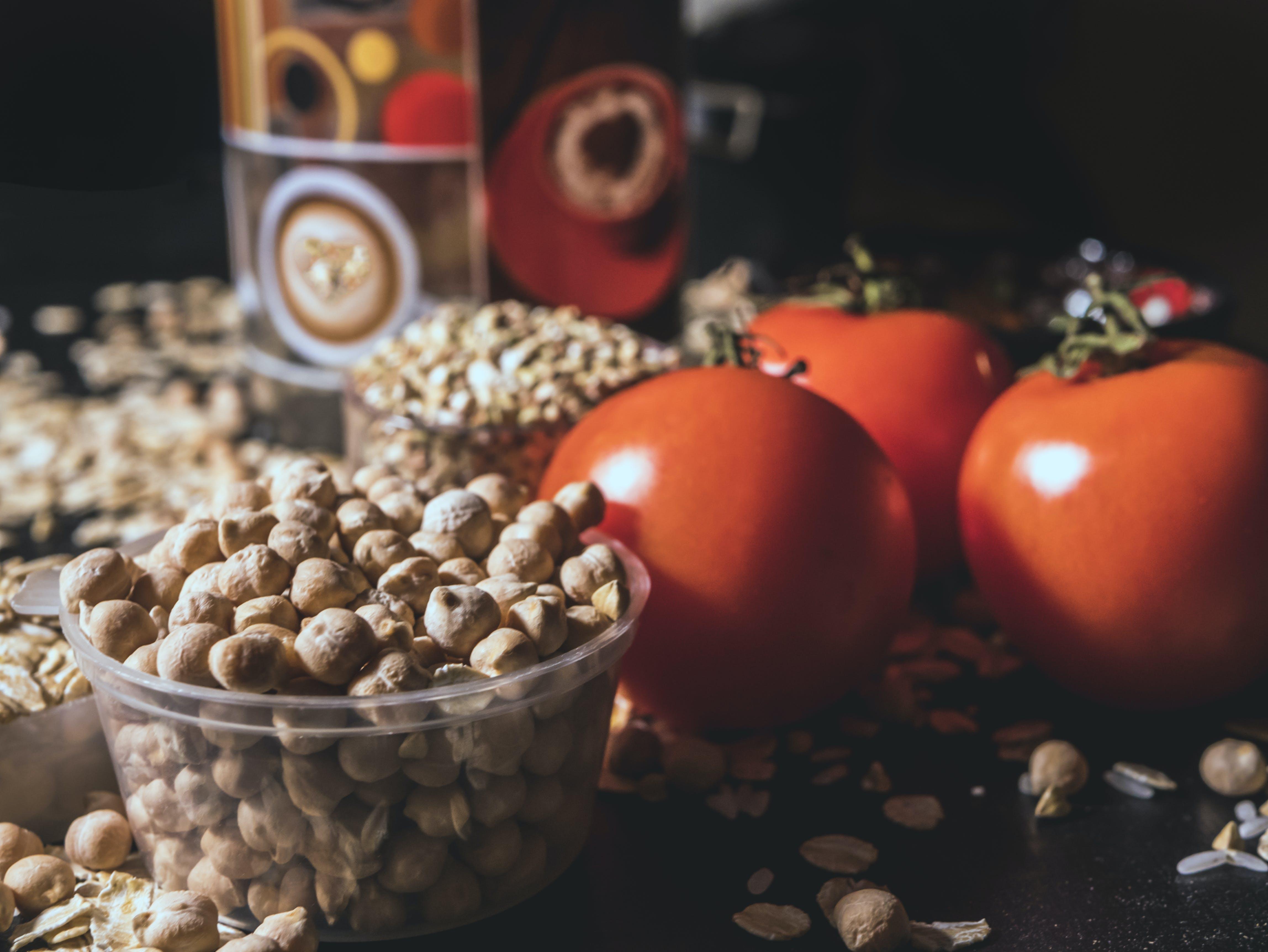 Brown Nut Lot Beside Orange Tomatoes