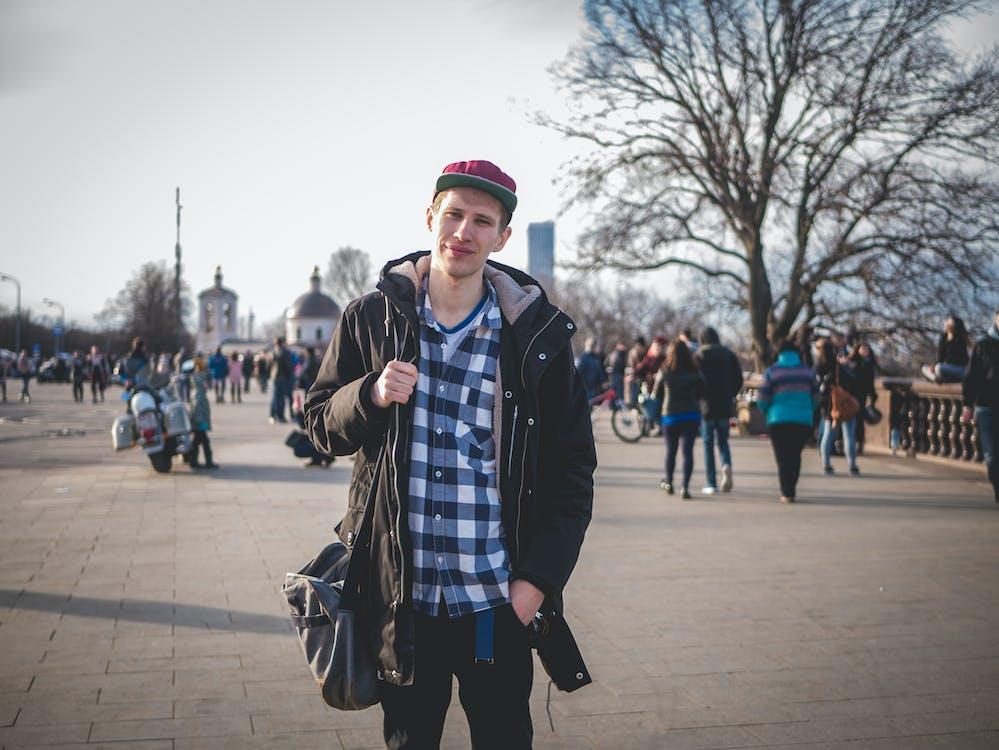 Photo of Man Wearing Black Zip-up Jacket