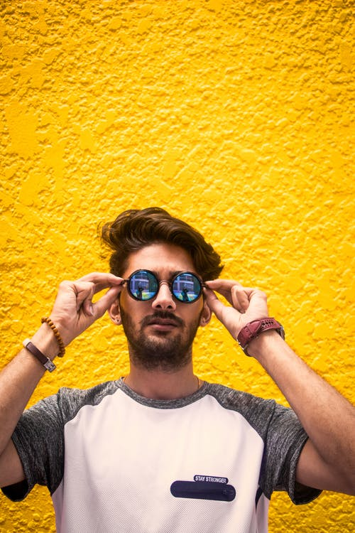 124ba236214d Man in White and Gray Shirt Wearing Sunglasses Against Yellow Wall