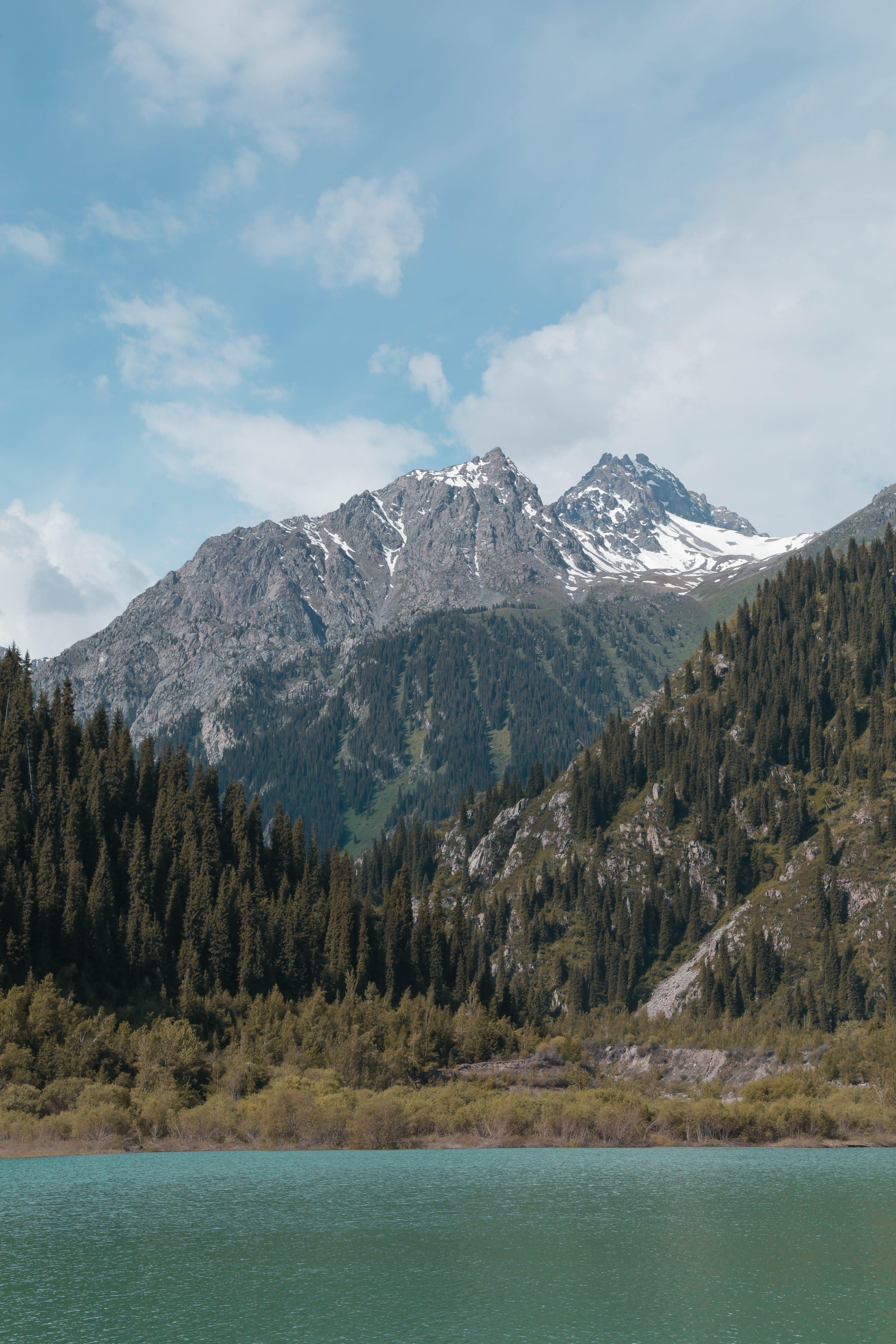 Snowcaps Mountain Near Body of Water