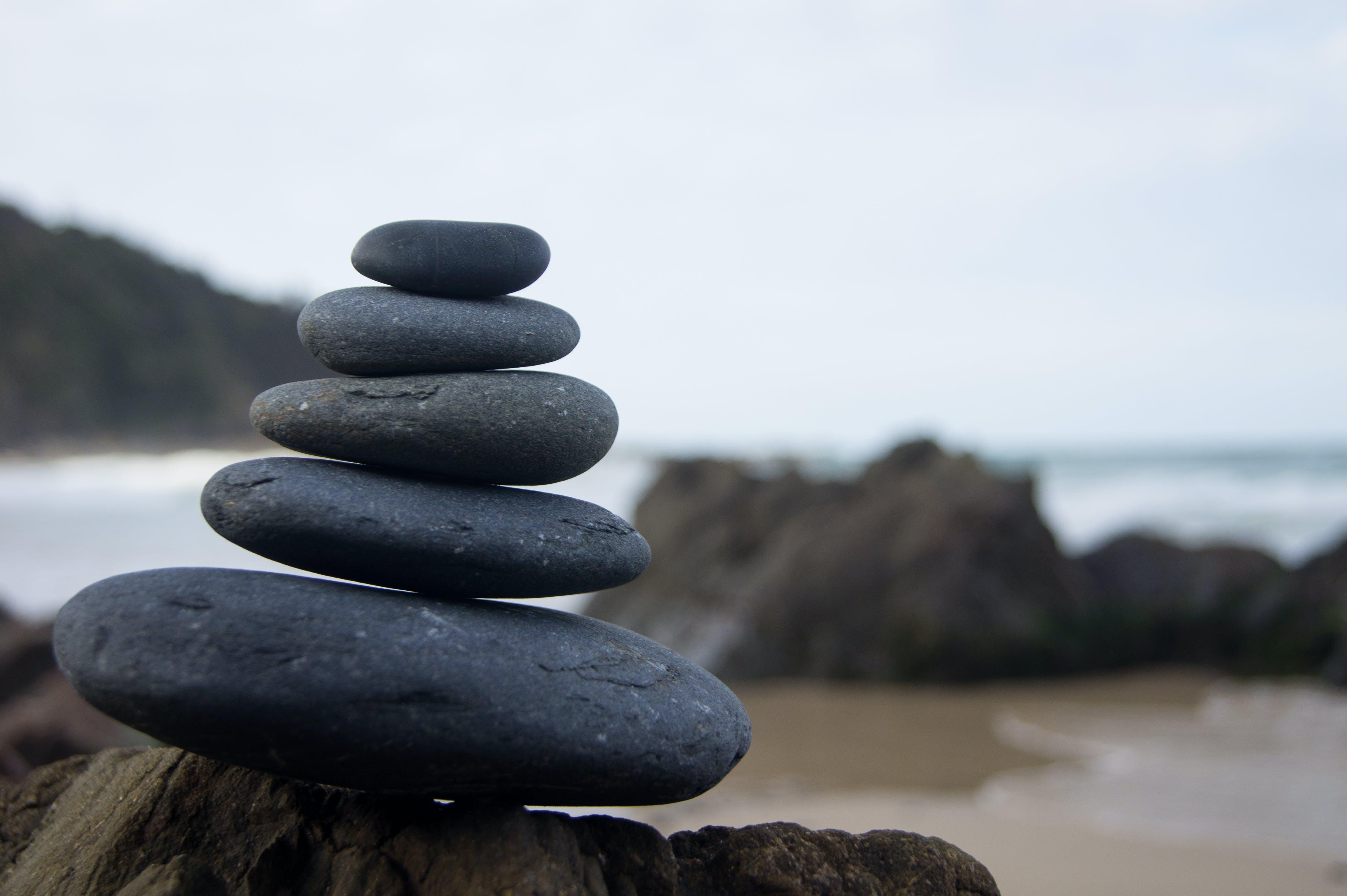 Photo of Stacked Rocks Near Shore