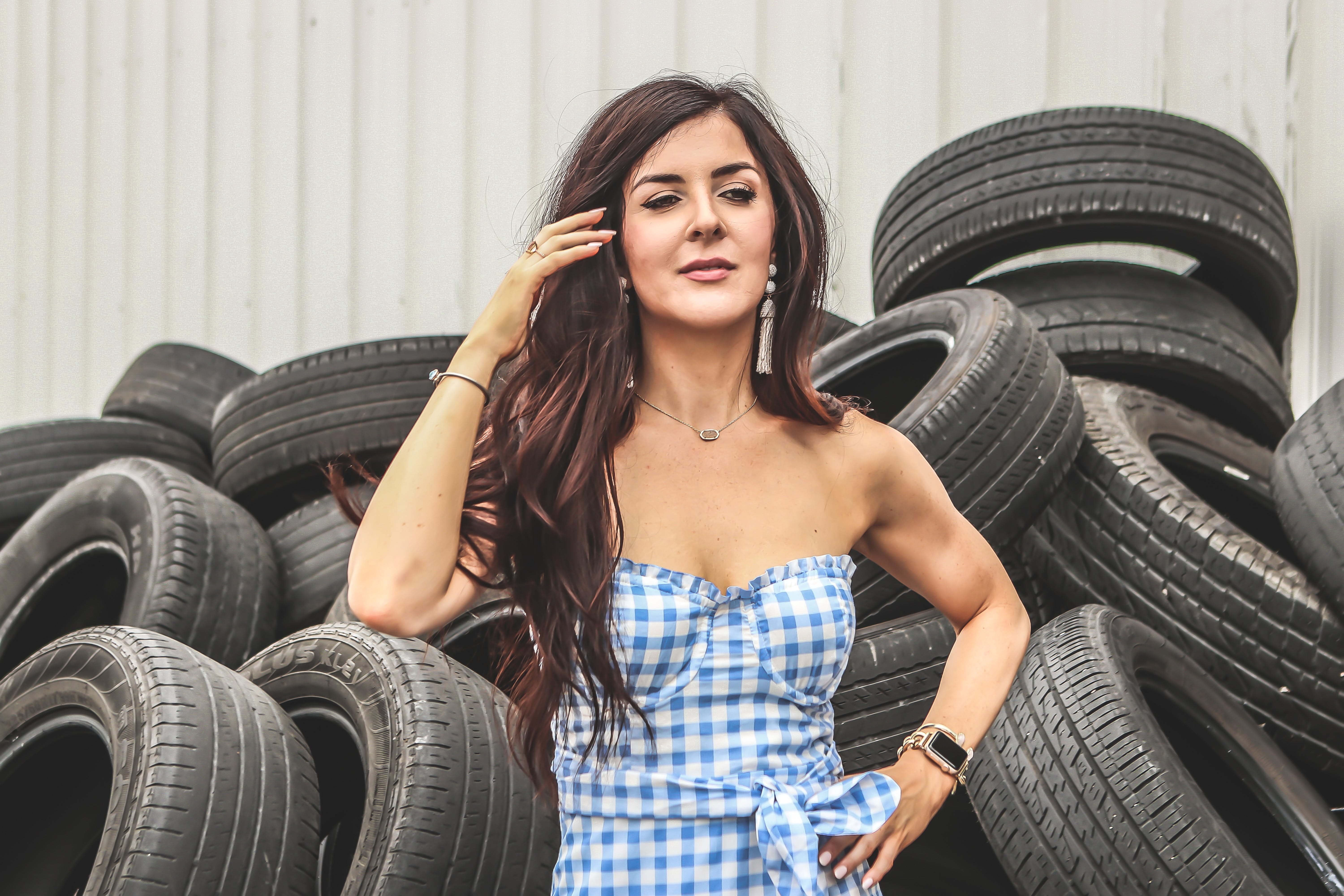 Woman Standing in Front of Car Tires