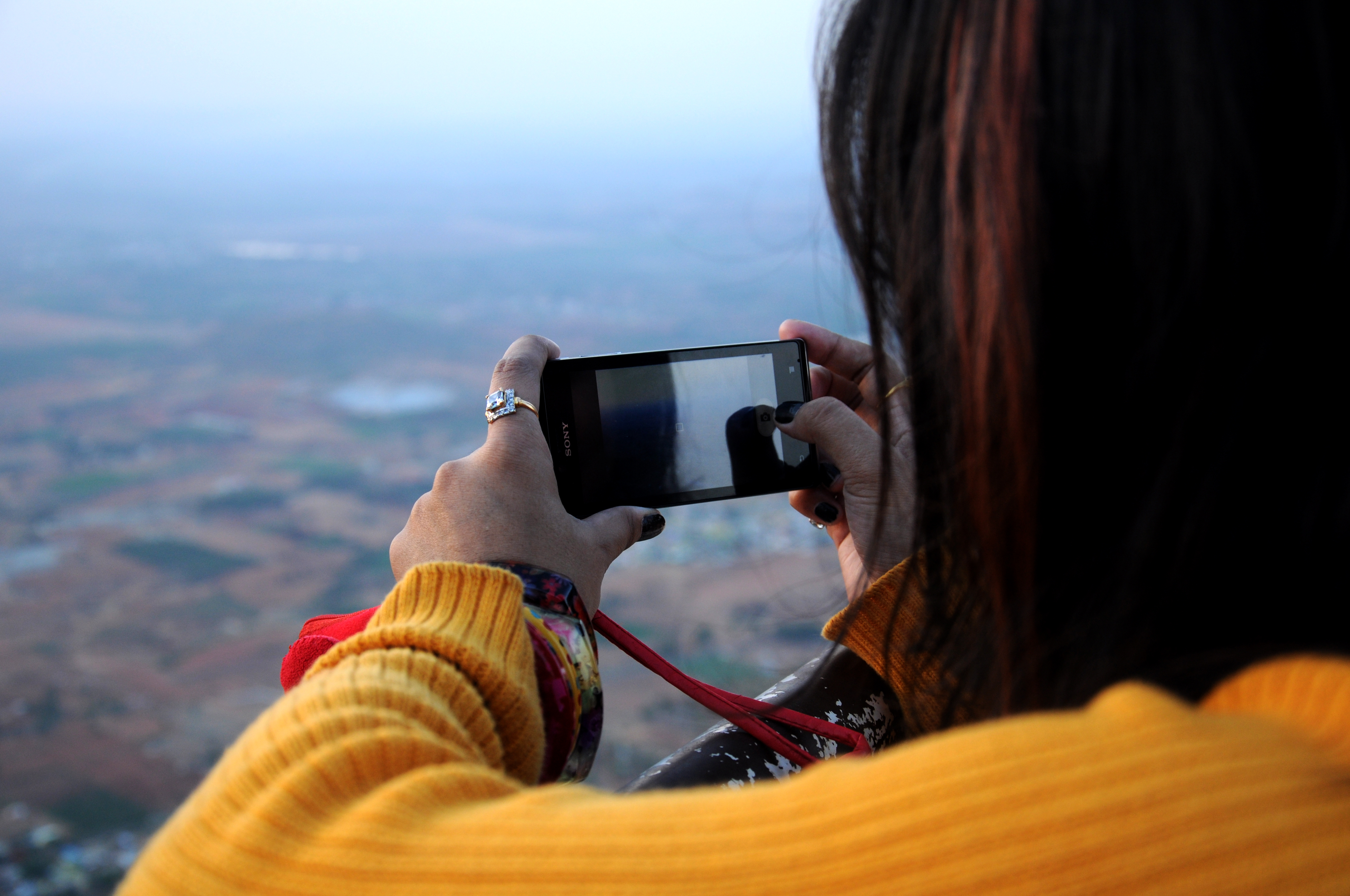 Photo of Woman Taking Picture