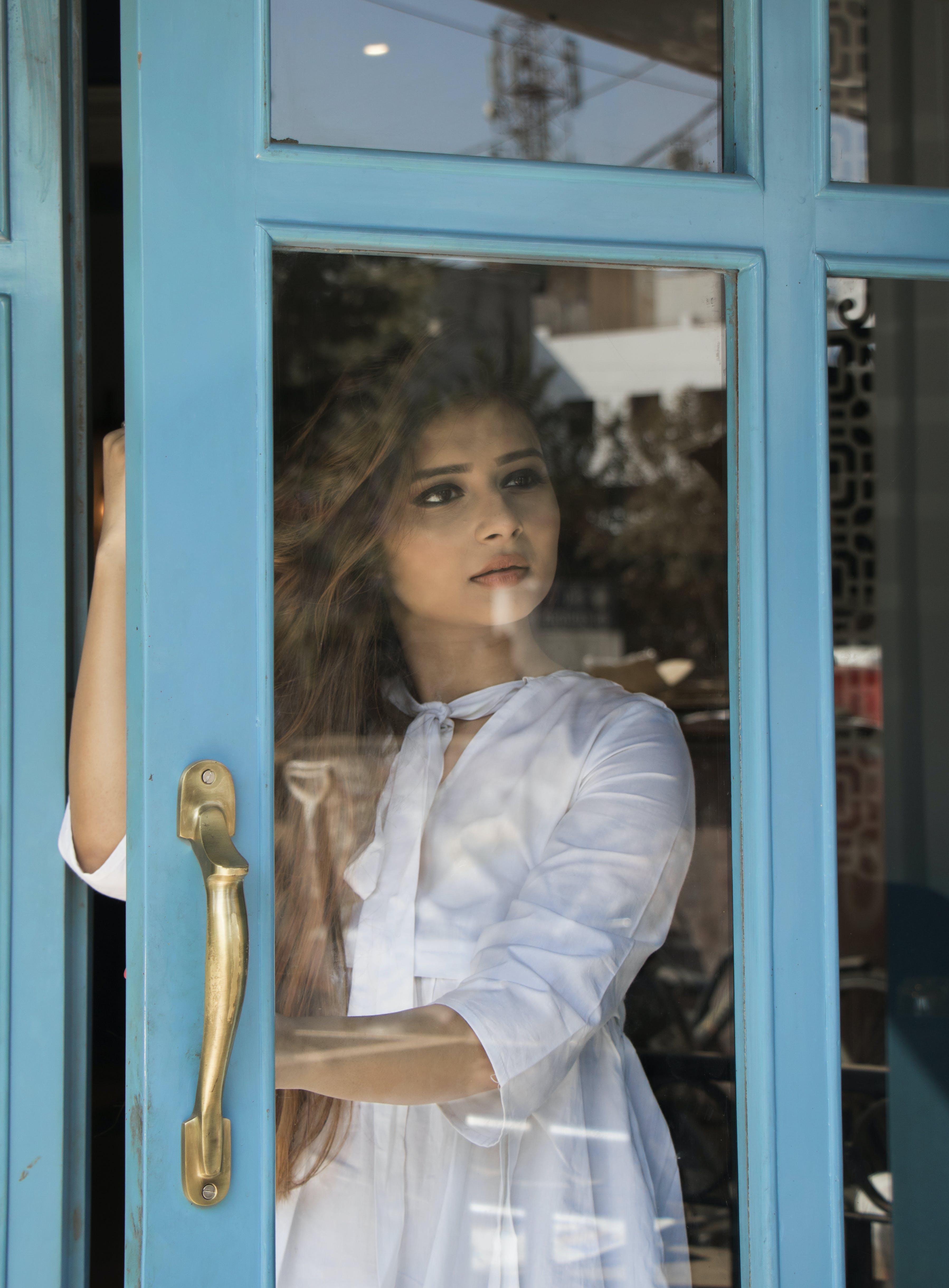 Photography of Woman Opening Door