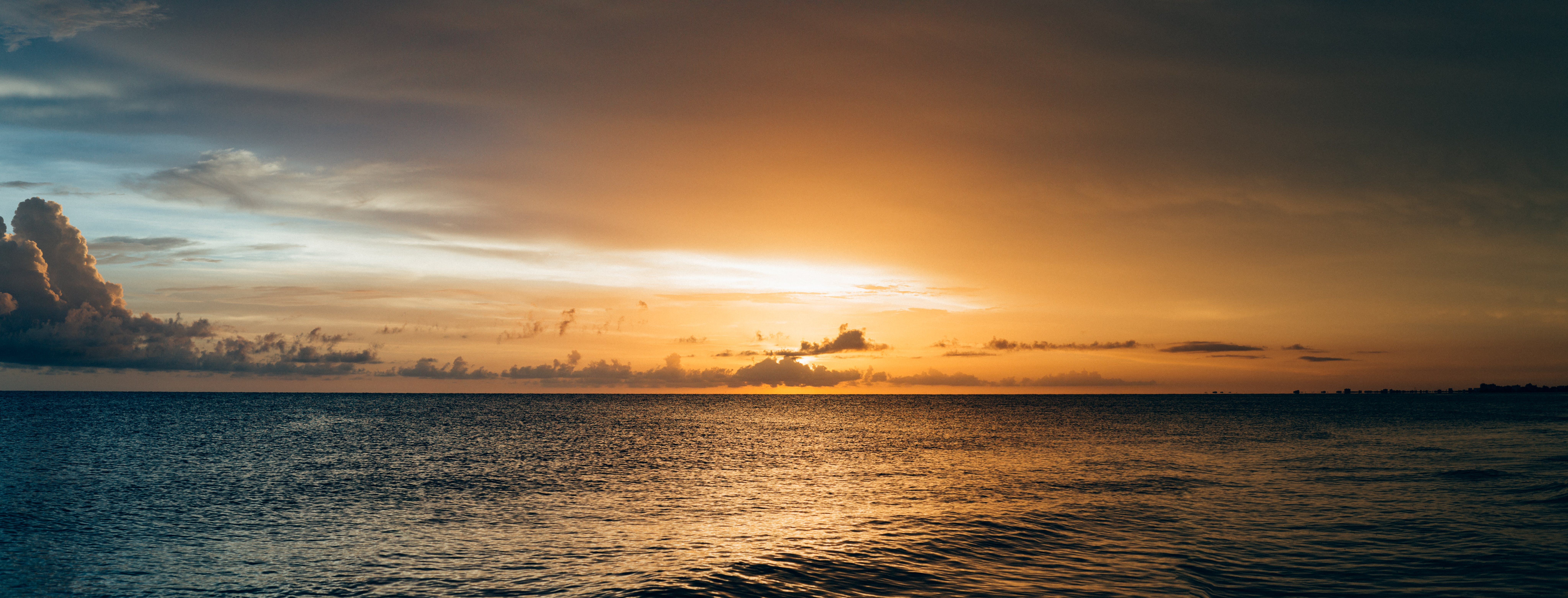 Scenery of Sea Water during Sunset