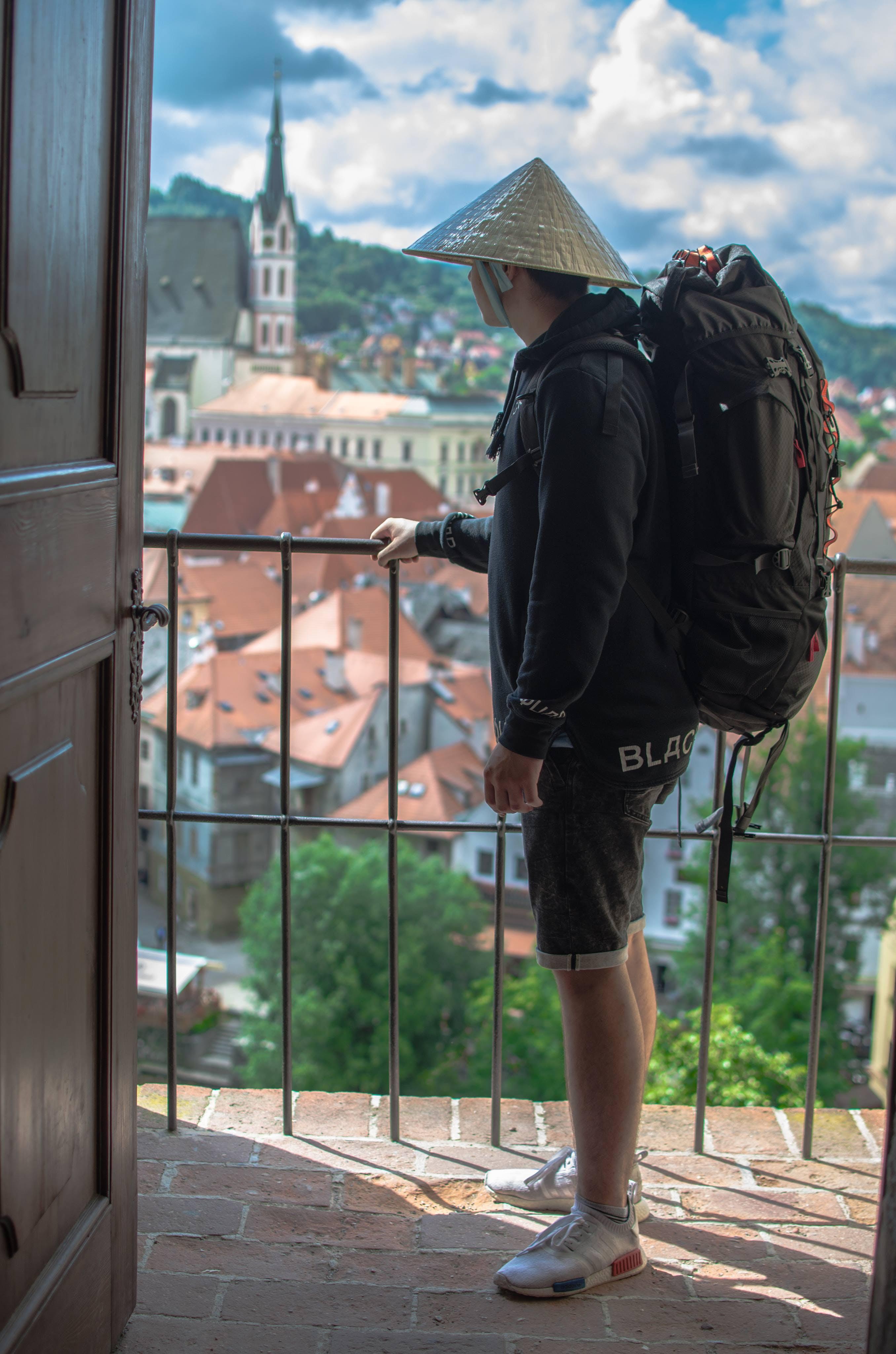 Man Standing on Balcony