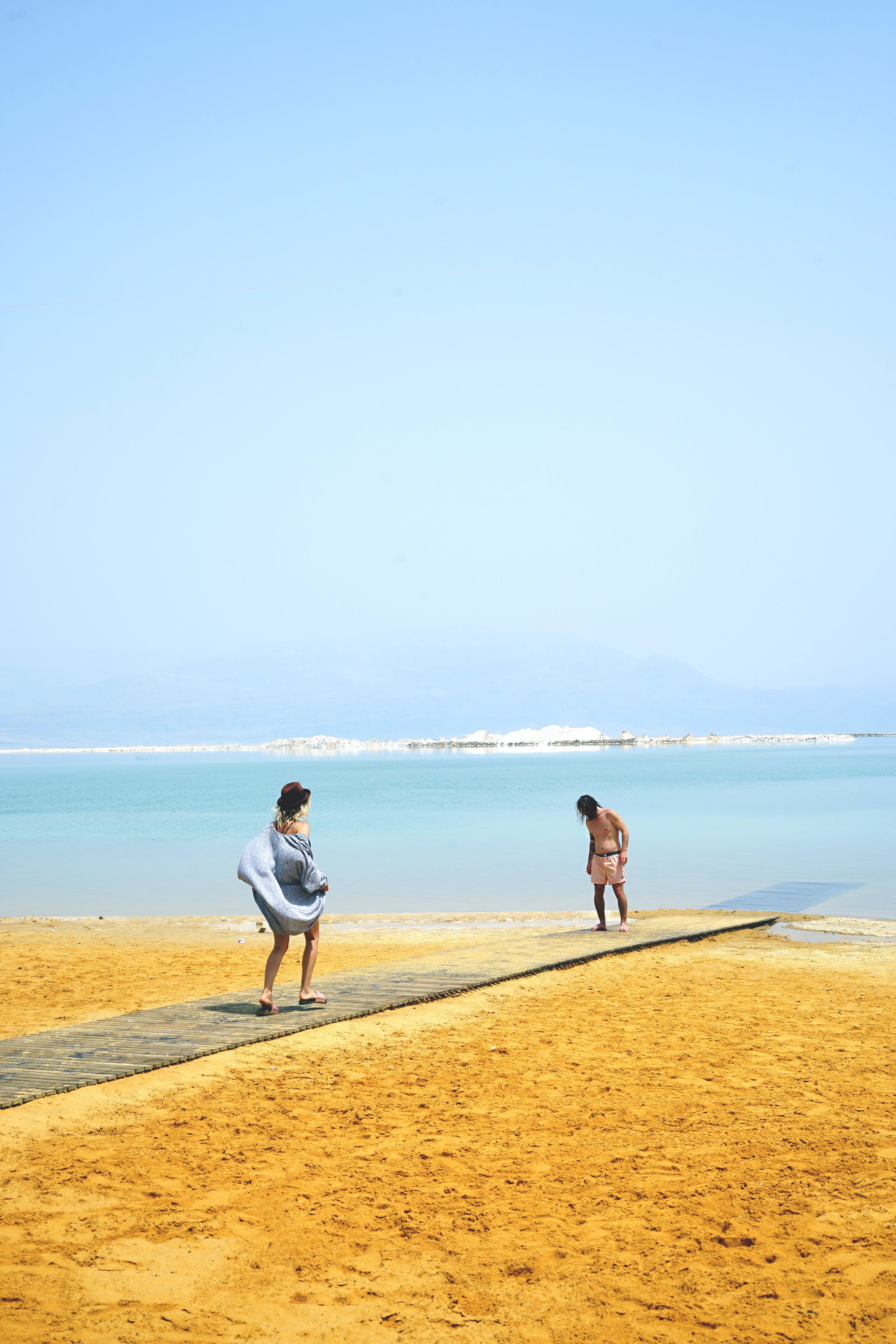 Two Person Standing on the Beach