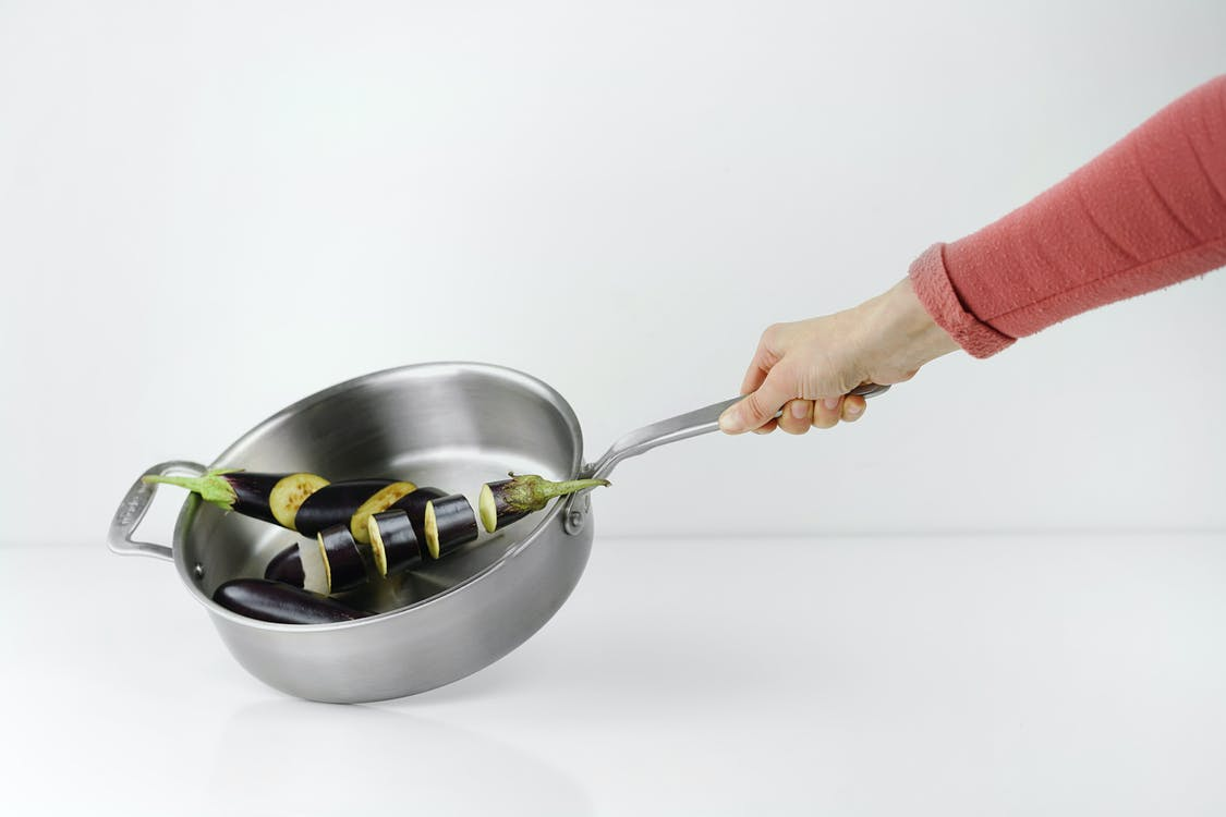 Person Holding Stainless Steel Casserole