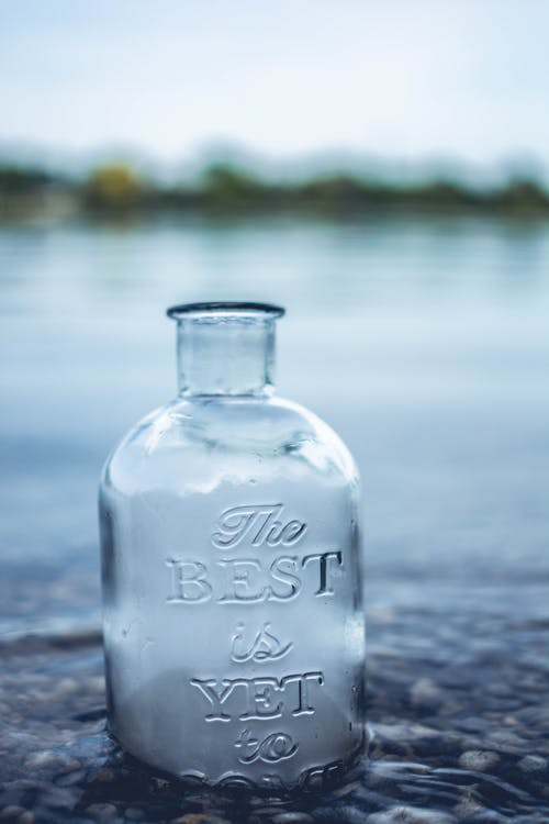 Clear Glass Jar in Body of Water