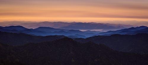 Бесплатное стоковое фото с восход, горный хребет, горы, живописный