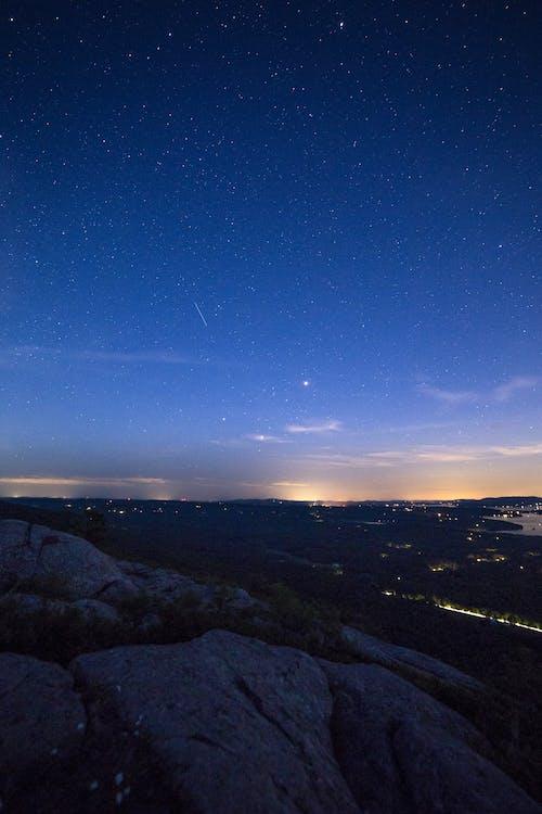 Kostnadsfri bild av berg, himmel, kändisar, mörk