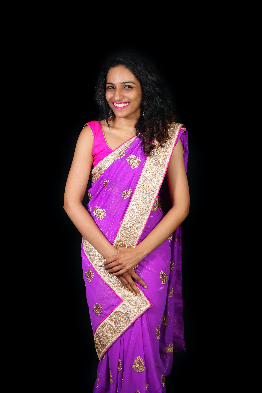 Photo of Woman Wearing Purple Sari Dress