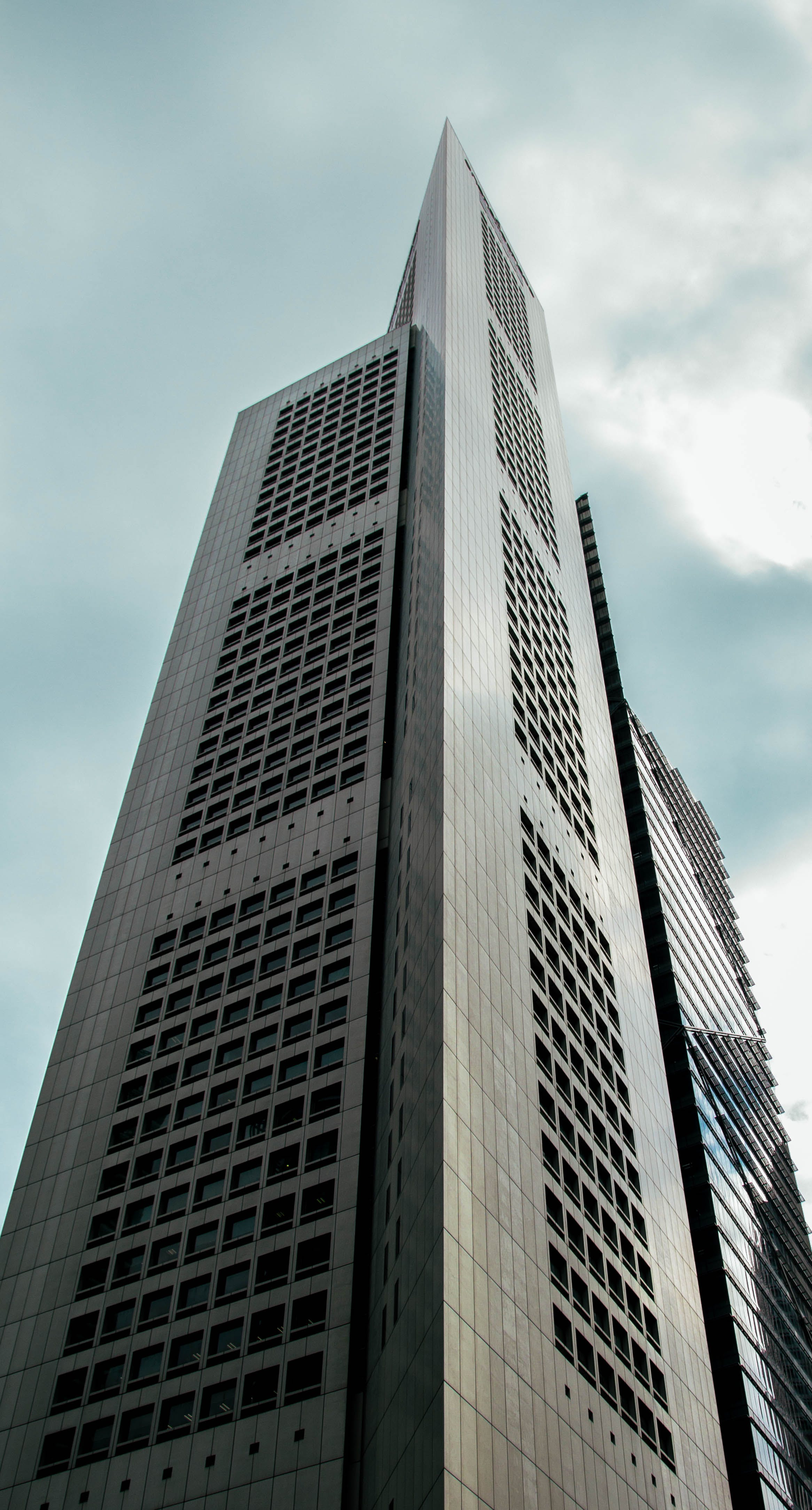 Gray Concrete Building Under White and Blue Cloudy Sky during Daytime
