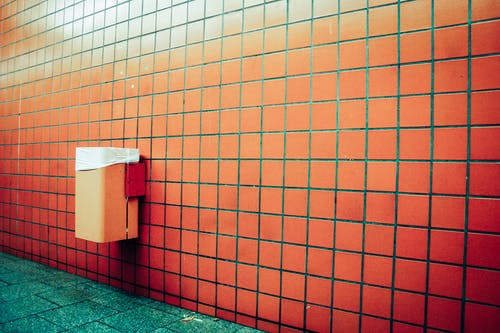 Brown Brick Wall With Green Floor Tiles