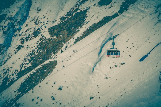 Cable Car Above Snow Covered Mountain