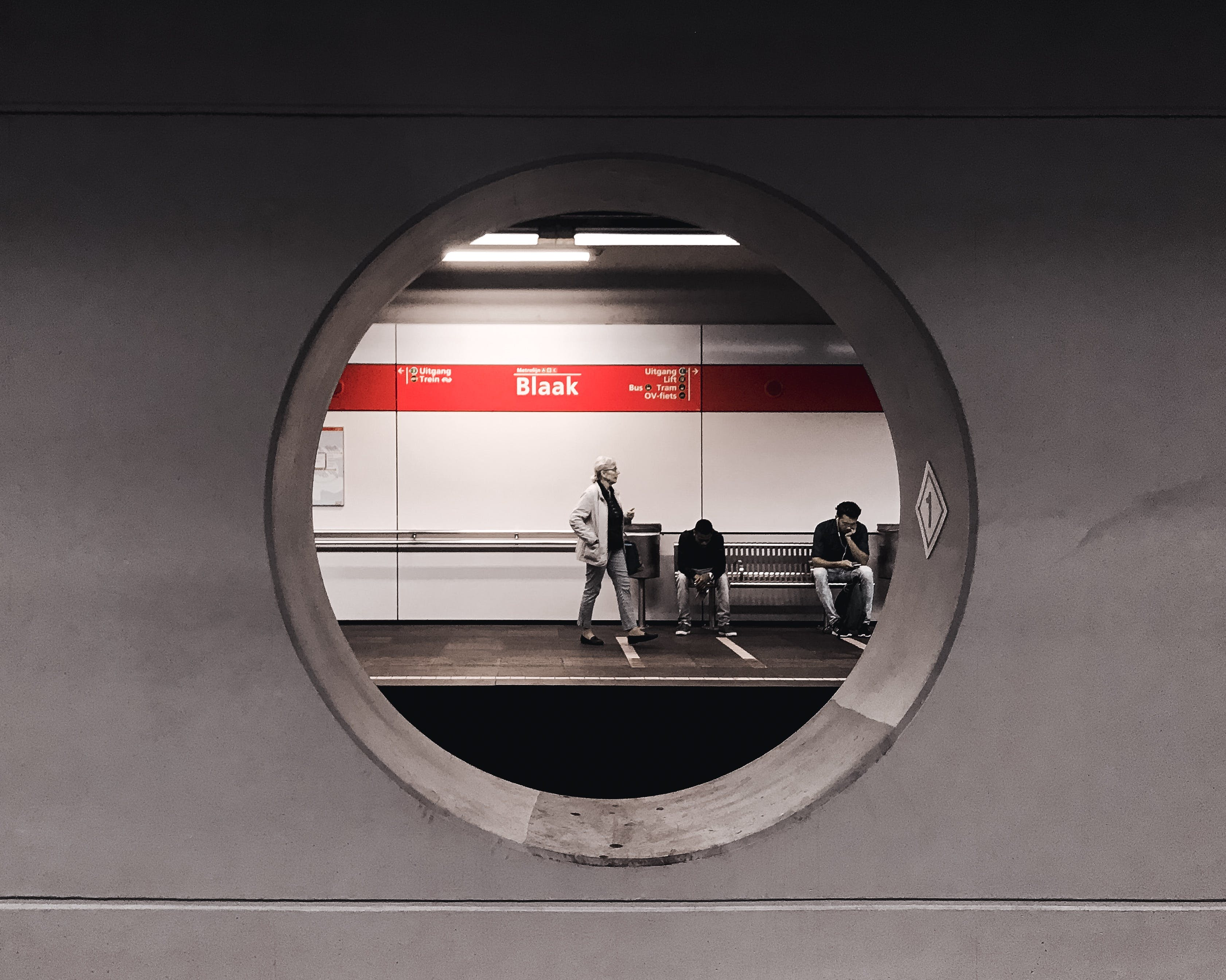 Grayscale Photography of People Waiting in Train Station