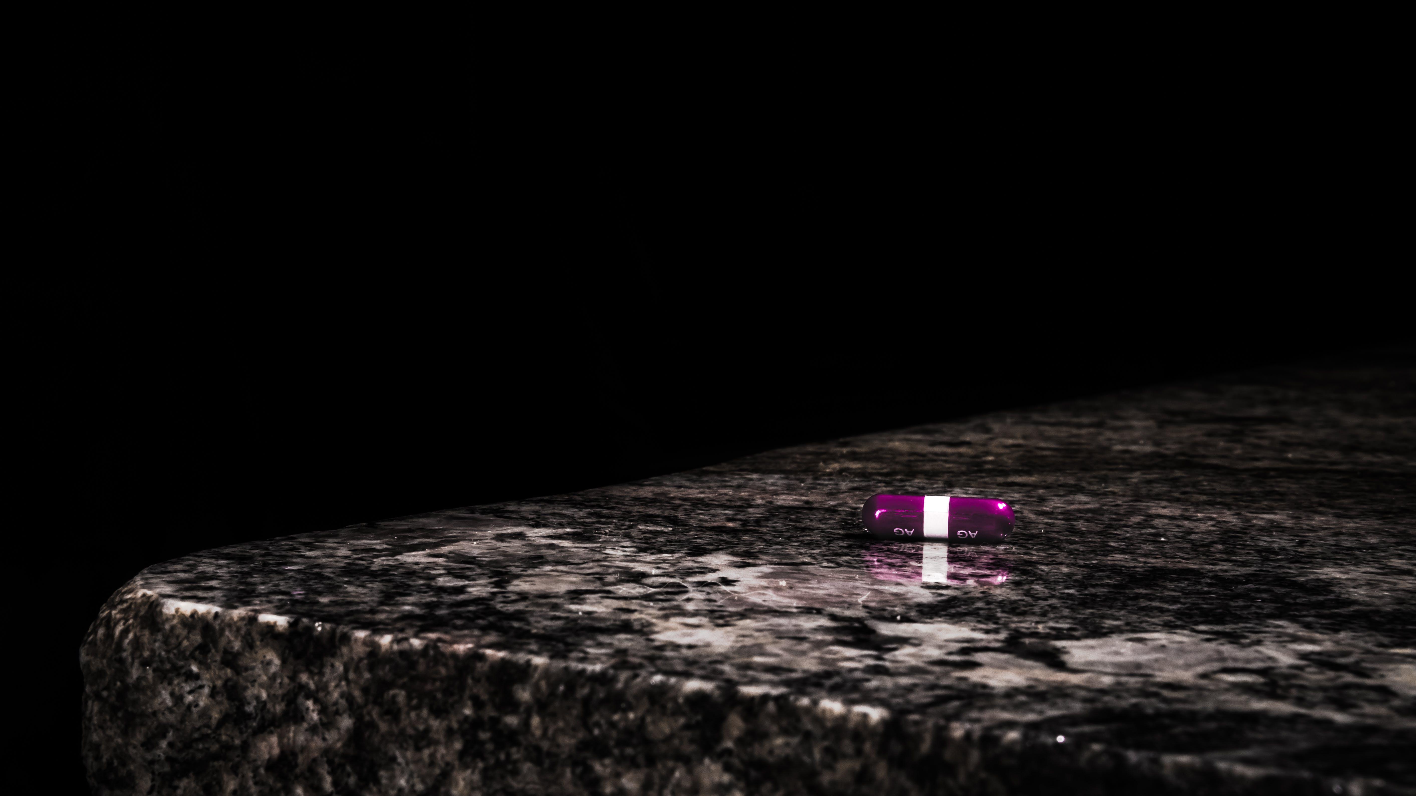Purple Medication Tablet on Table