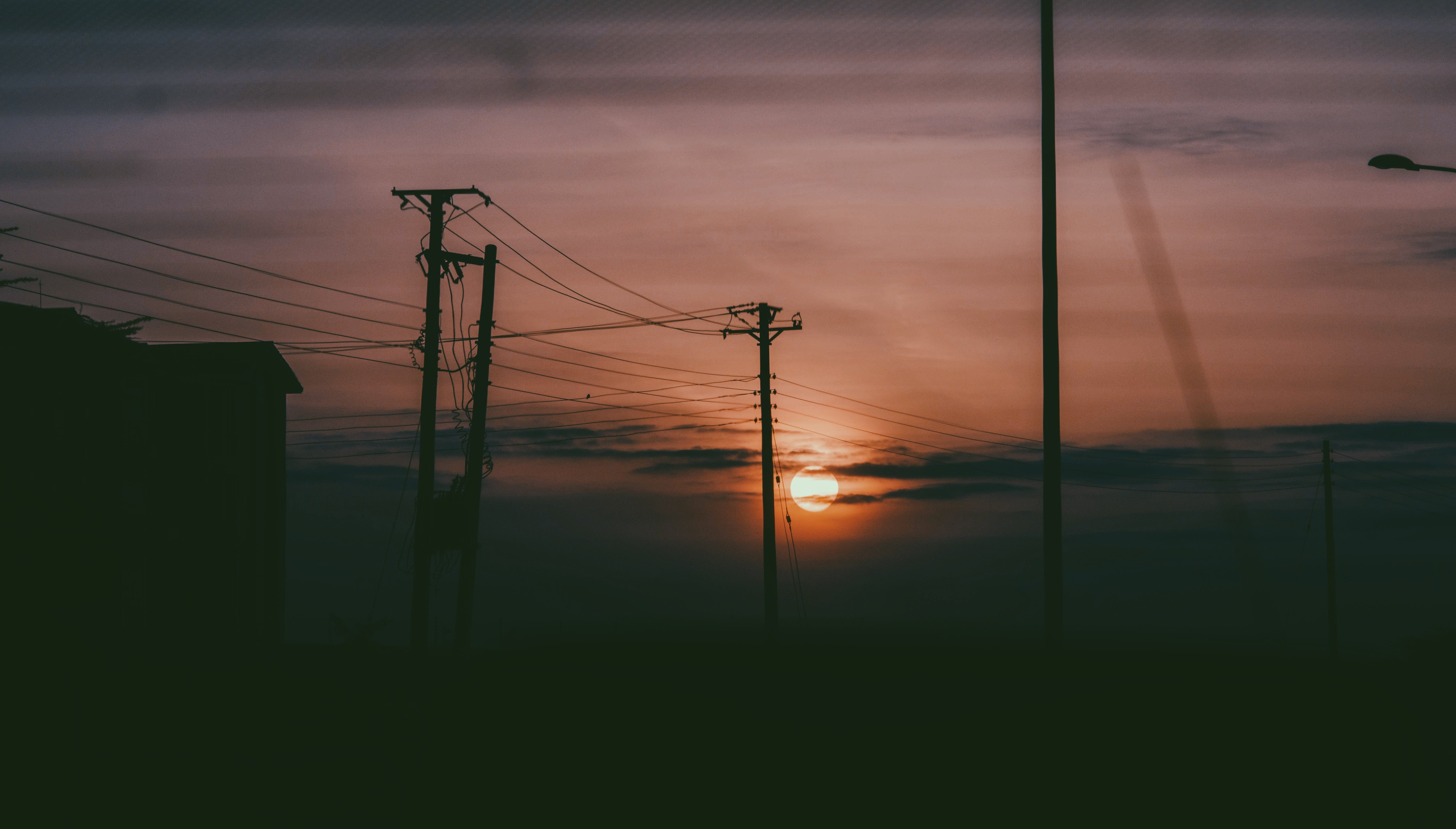 Silhouette Photo Of Electric Posts During Sunset