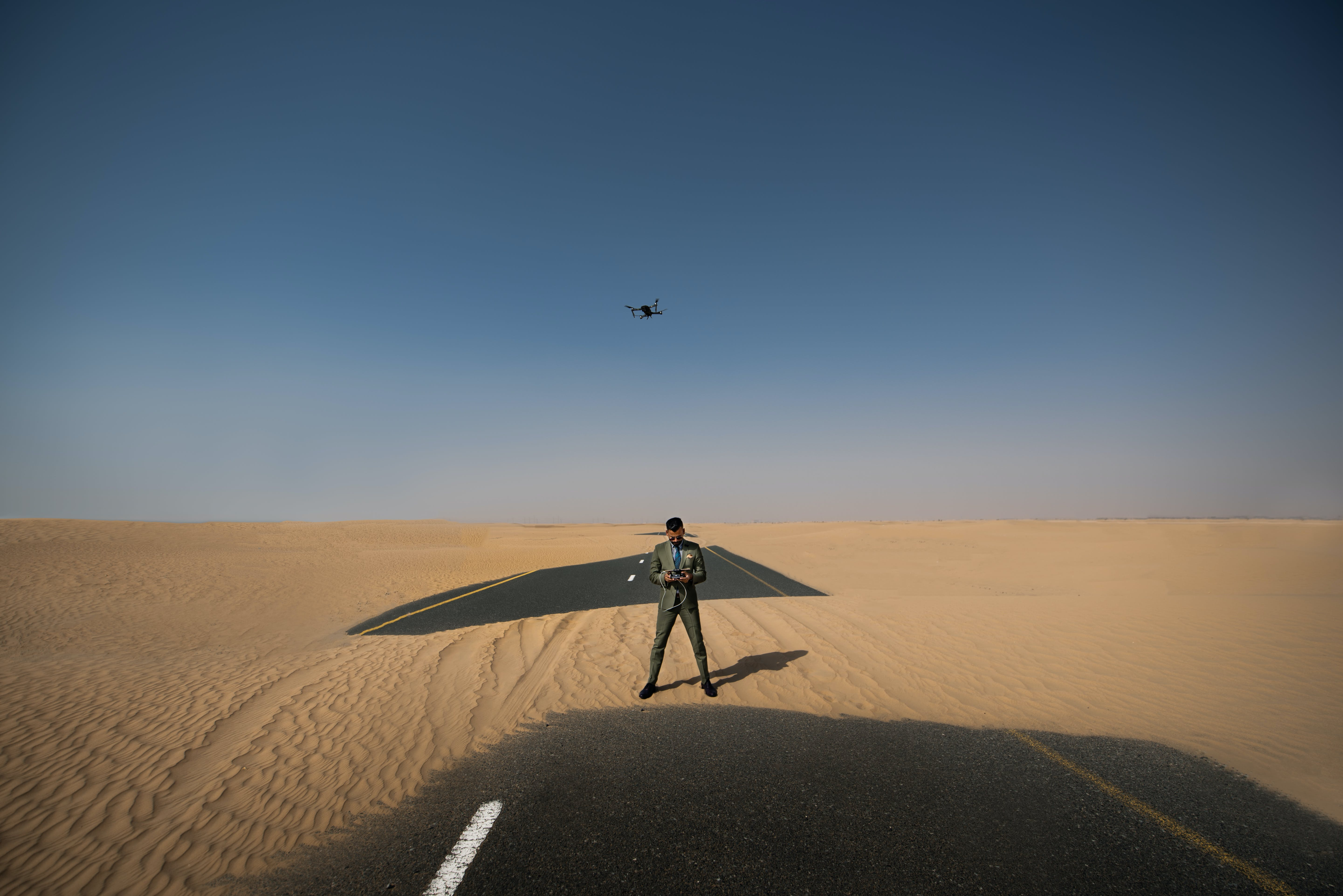 Man Standing in the Middle of Desert Place