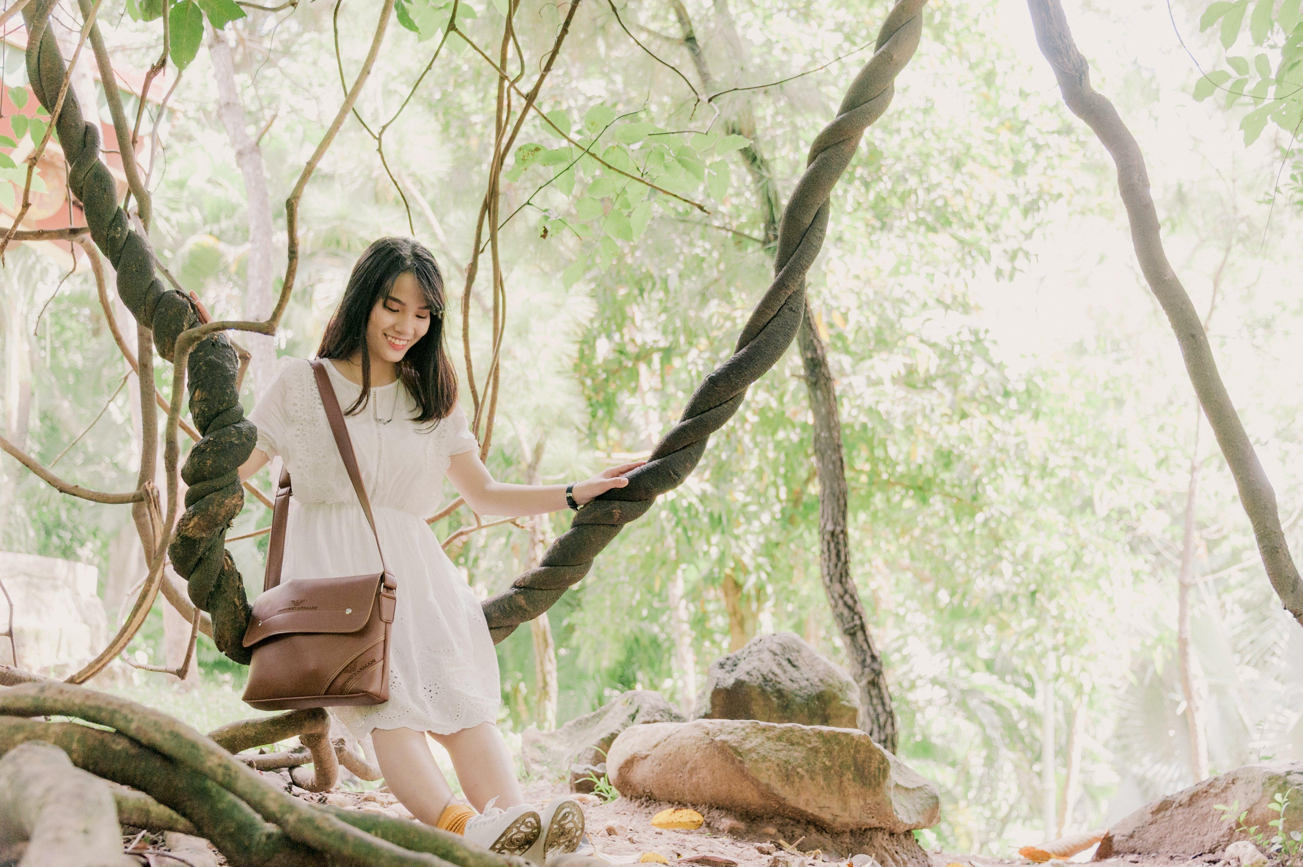 Woman Standing Near Trees