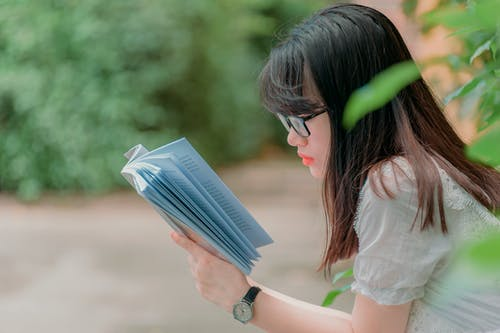 Close-Up Photography of Girl Reading Book