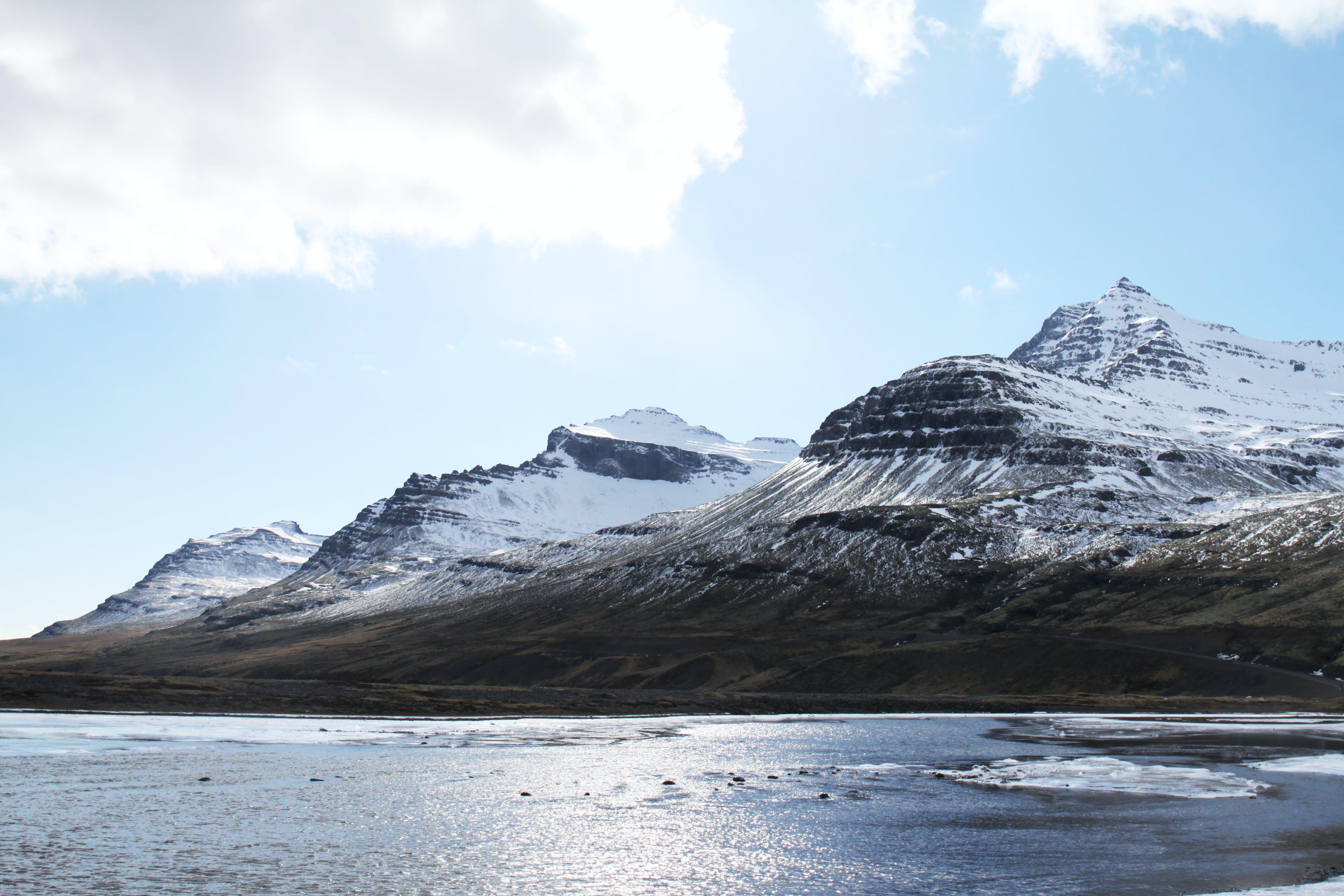 Foto profissional grátis de água, alto, cênico, com frio