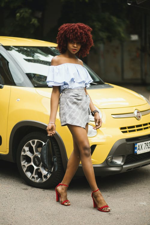 Woman Wearing White Off-shoulder Dress Standing Next To Yellow Fiat 500