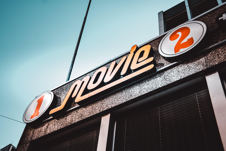 1 Movie 2 Signage Under White Clouds