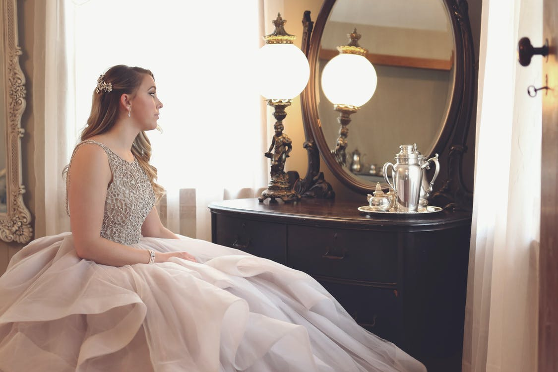Woman Wearing Gown Looking at Mirror
