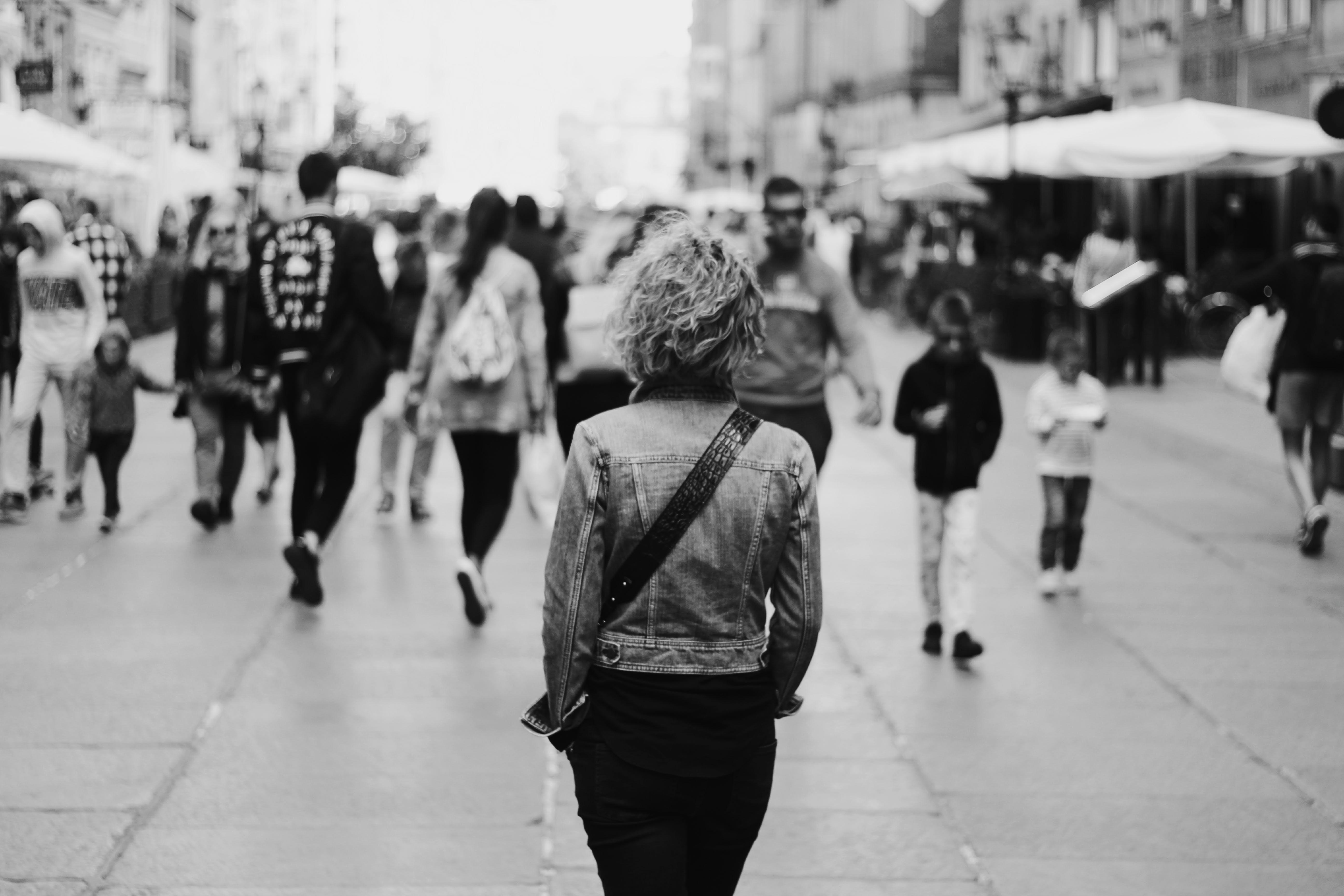 Grayscale Photo Of Woman Walking