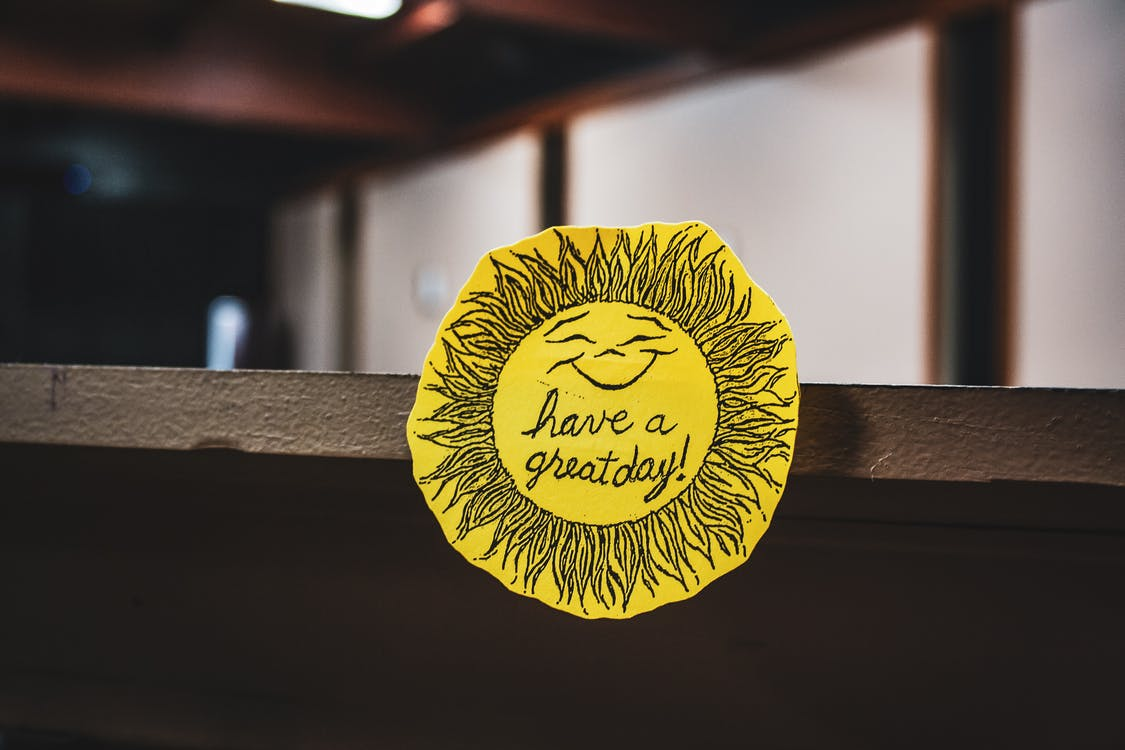 Have a Great Day Sticker on Brown Surface