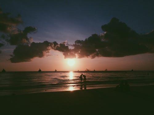 岸邊, 日落, 海濱, 海灘 的 免费素材照片