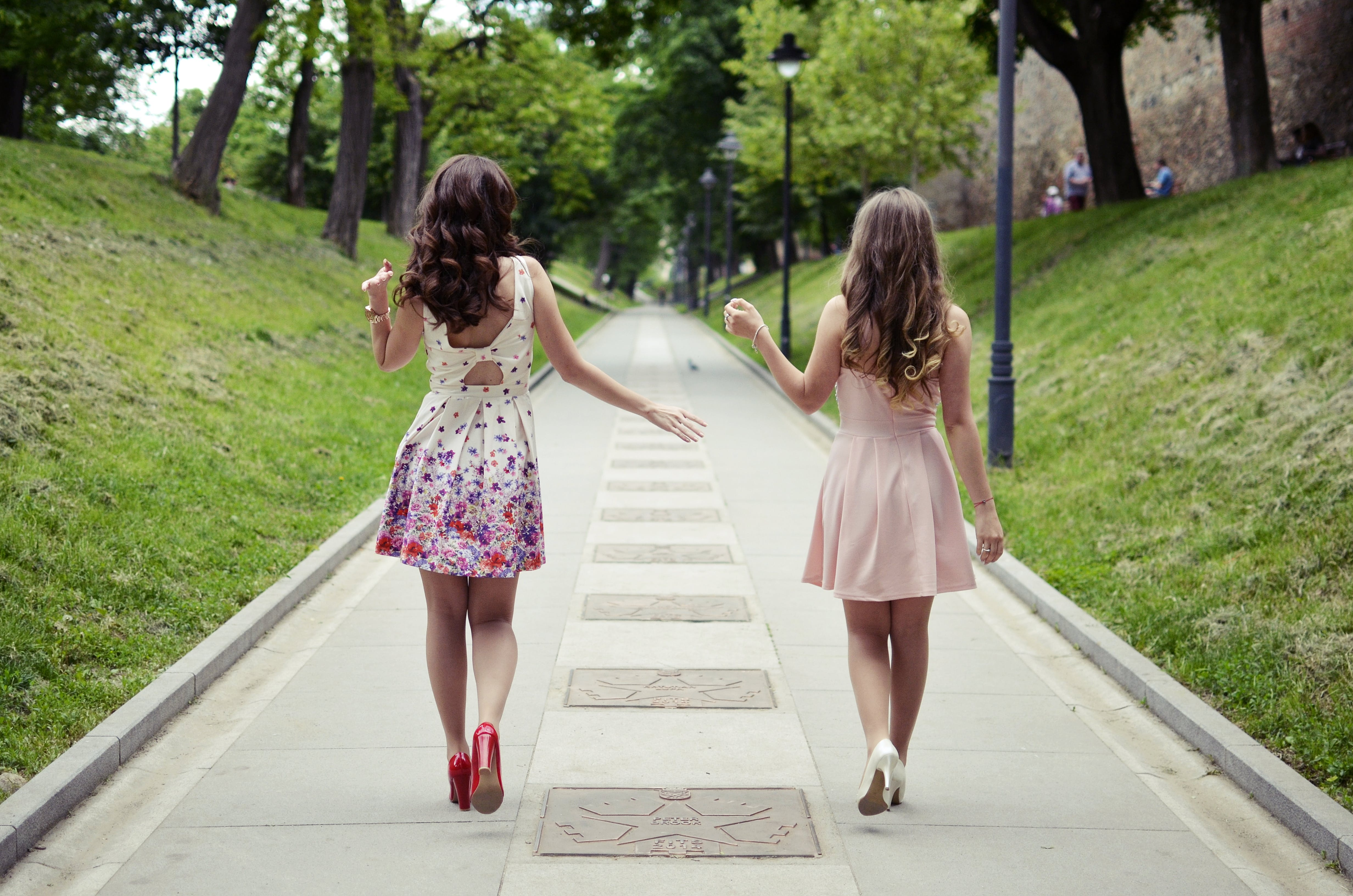 Two Women Walking On Pathway