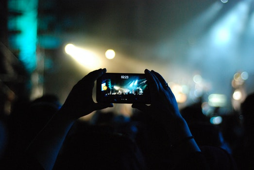 Photo of Person Recording Video on a Concert