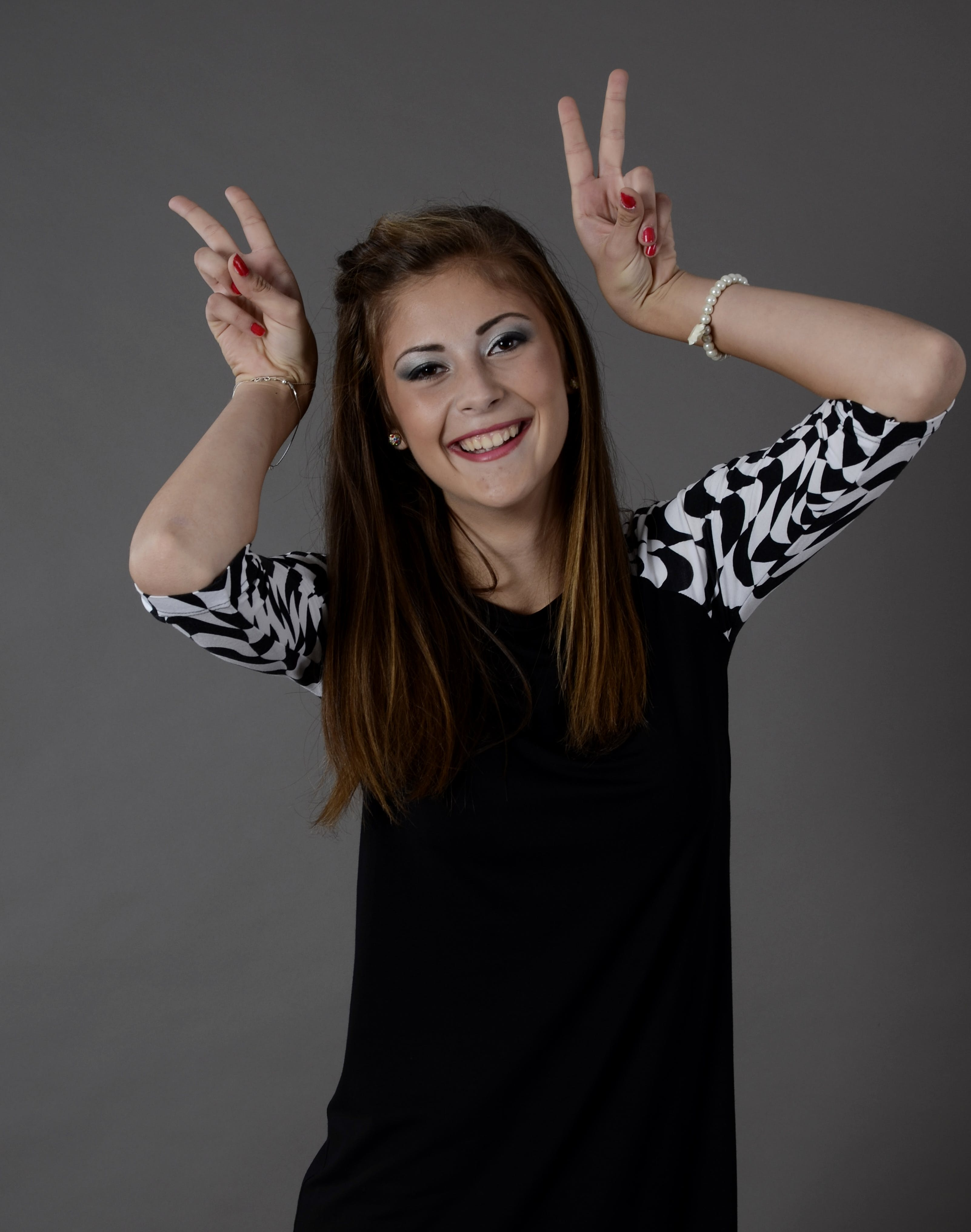 Woman Smiling and Doing Peace Signs