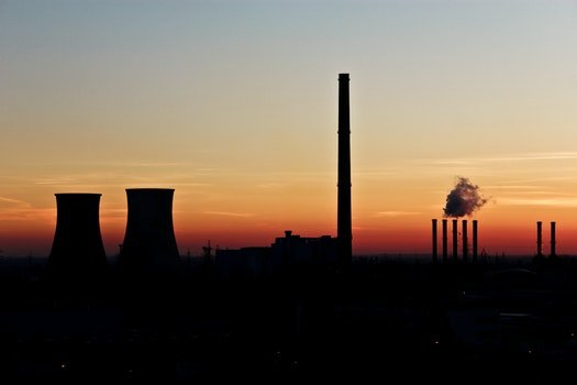 Silhouette Photo of Factory during Dusk