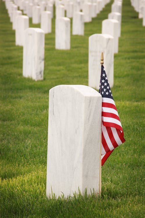 Flag Of U.S.A. Standing Near Tomb