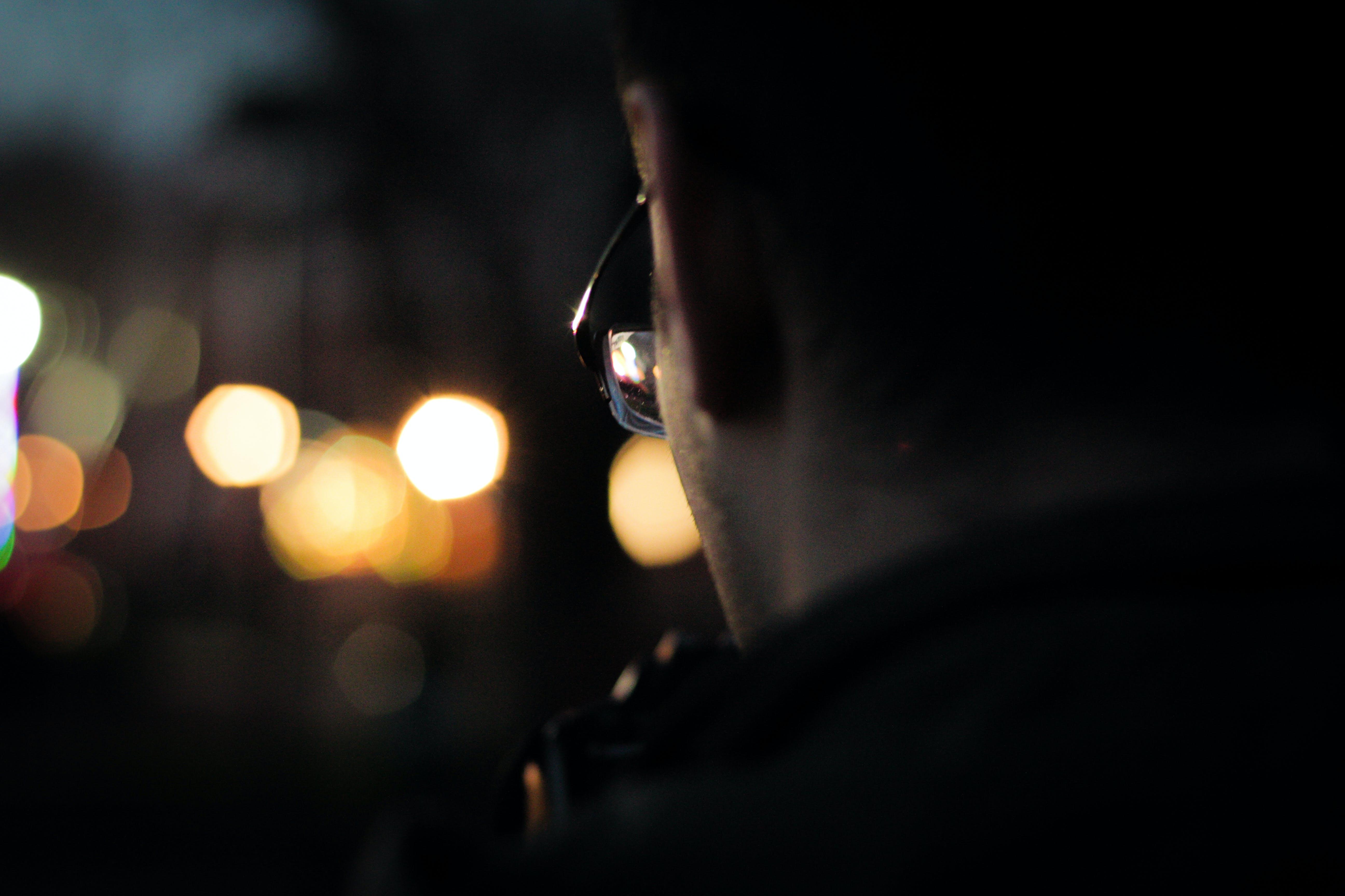 Man Wearing Black Framed Eyeglasses in Macro Photography